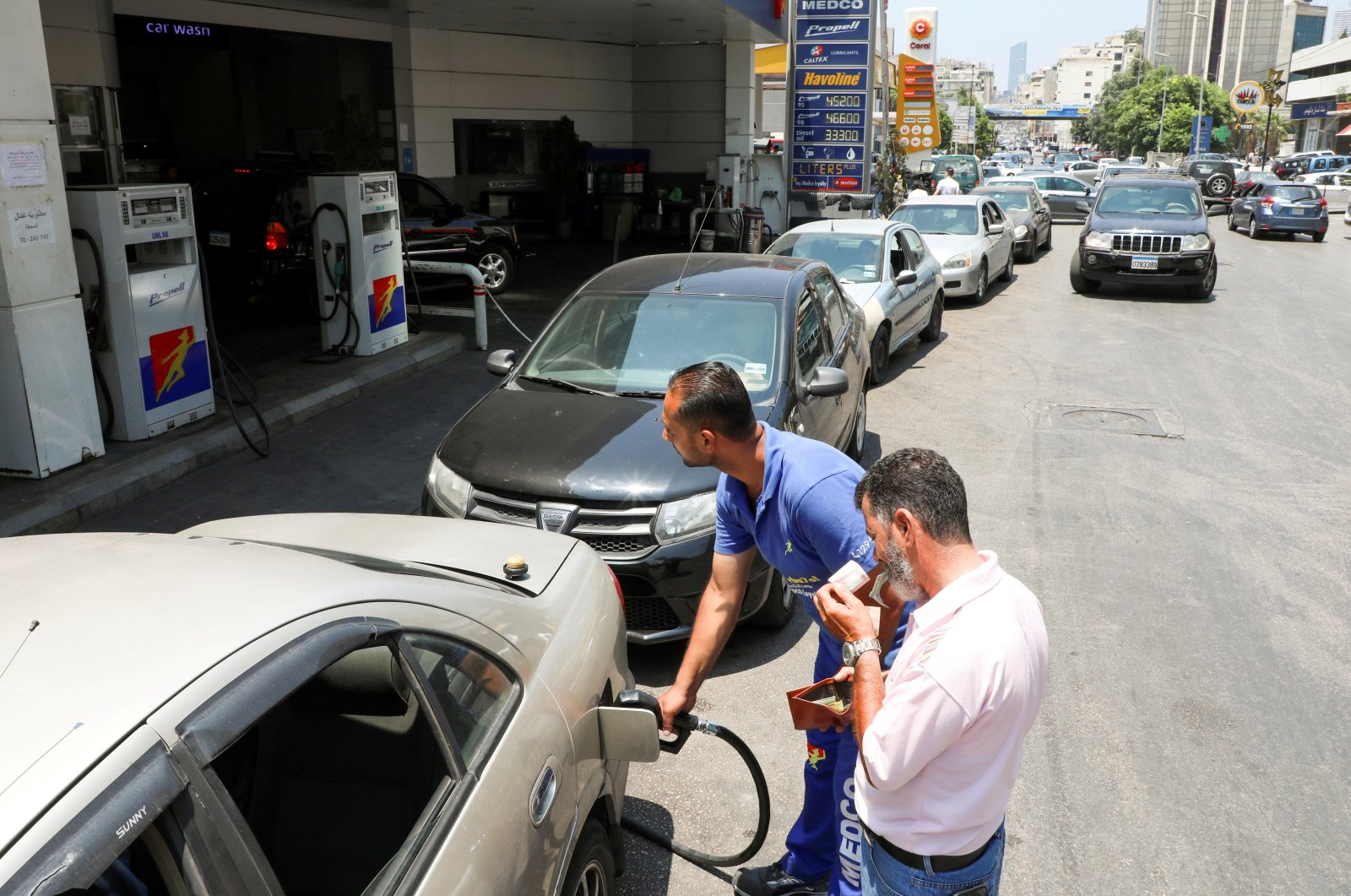 A worker fills up a car with fuel at a gas station in Beirut, Lebanon, June 24, 2021. (Reuters Photo)