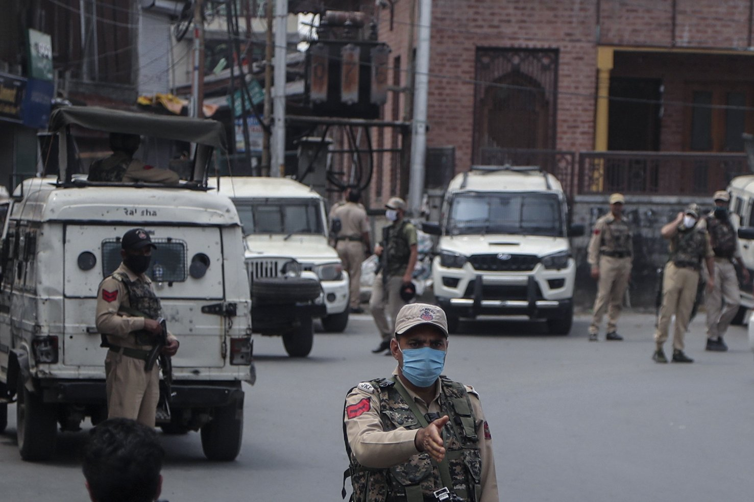 Indian police officers guard a closed market during a strike on the second anniversary of India's revocation of the disputed region's semi-autonomy in Srinagar, Indian-controlled Kashmir, Aug. 5, 2021. (AP Photo)