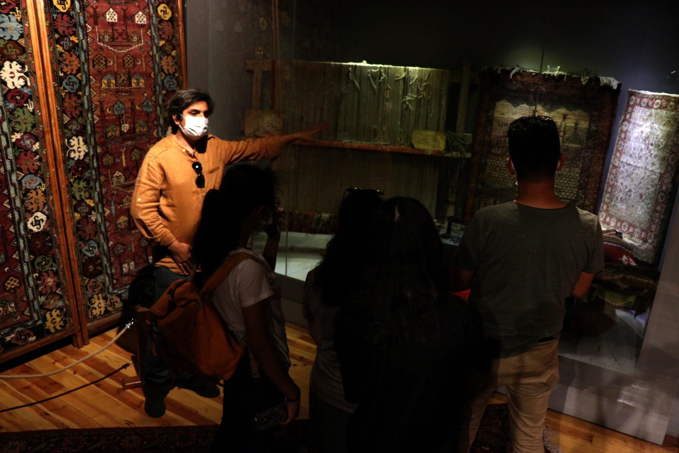 Visitors inspect a historical 100-year-old carpet as it is displayed in the Sille Museum in the Sille district of Konya, Turkey, Aug. 11, 2021. (AA Photo)