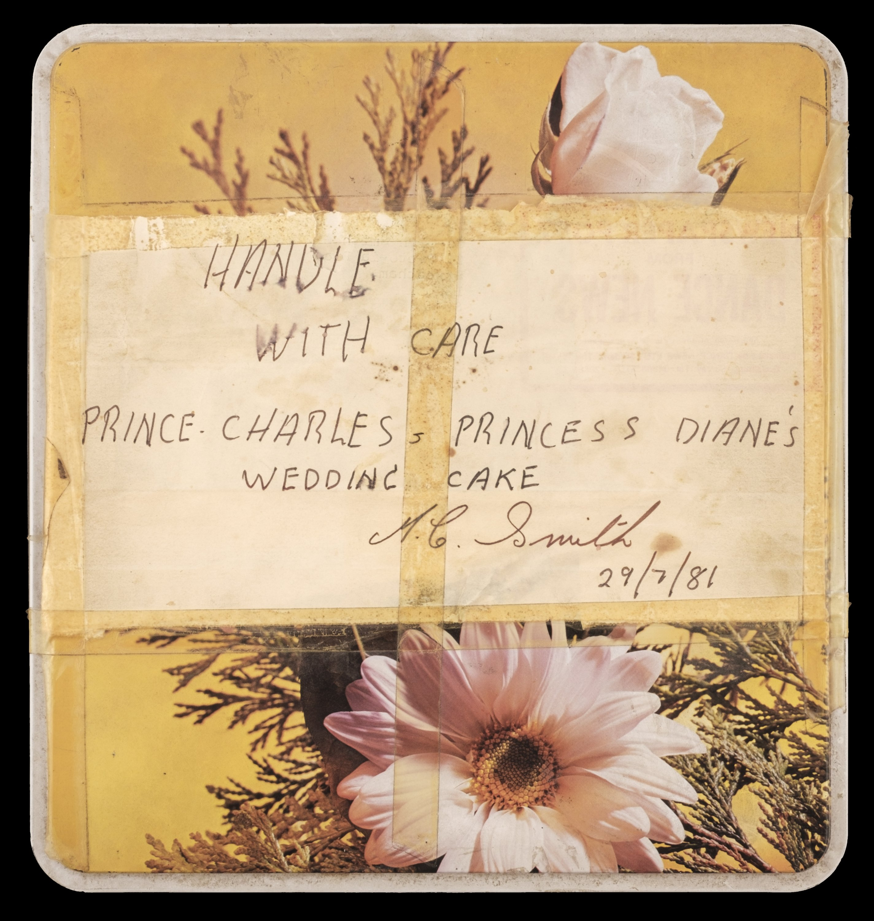 An undated handout photo made available by Dominic Winter Auctioneers shows a box containing a 40-year-old slice of Britain's Prince Charles and Diana's wedding cake.  (EPA/Dominic Winter Auctioneers Photo)