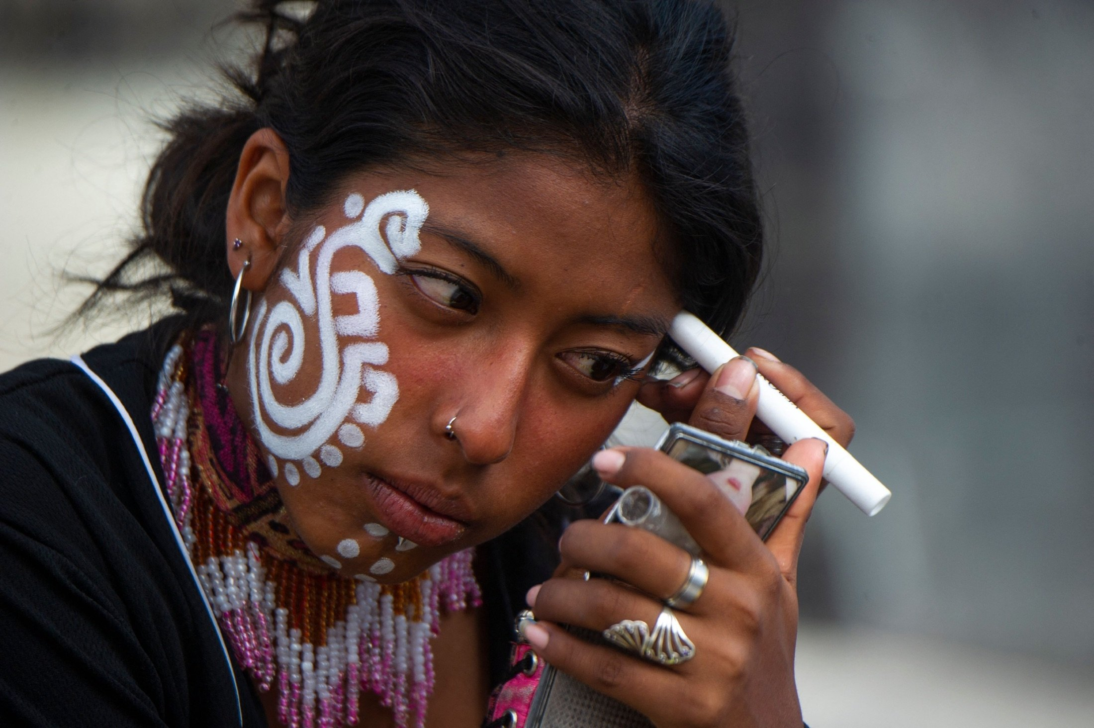 A woman prepares to perform an Aztec dance at the Zocalo square in Mexico City, Mexico, July 31, 2021. (AFP Photo)