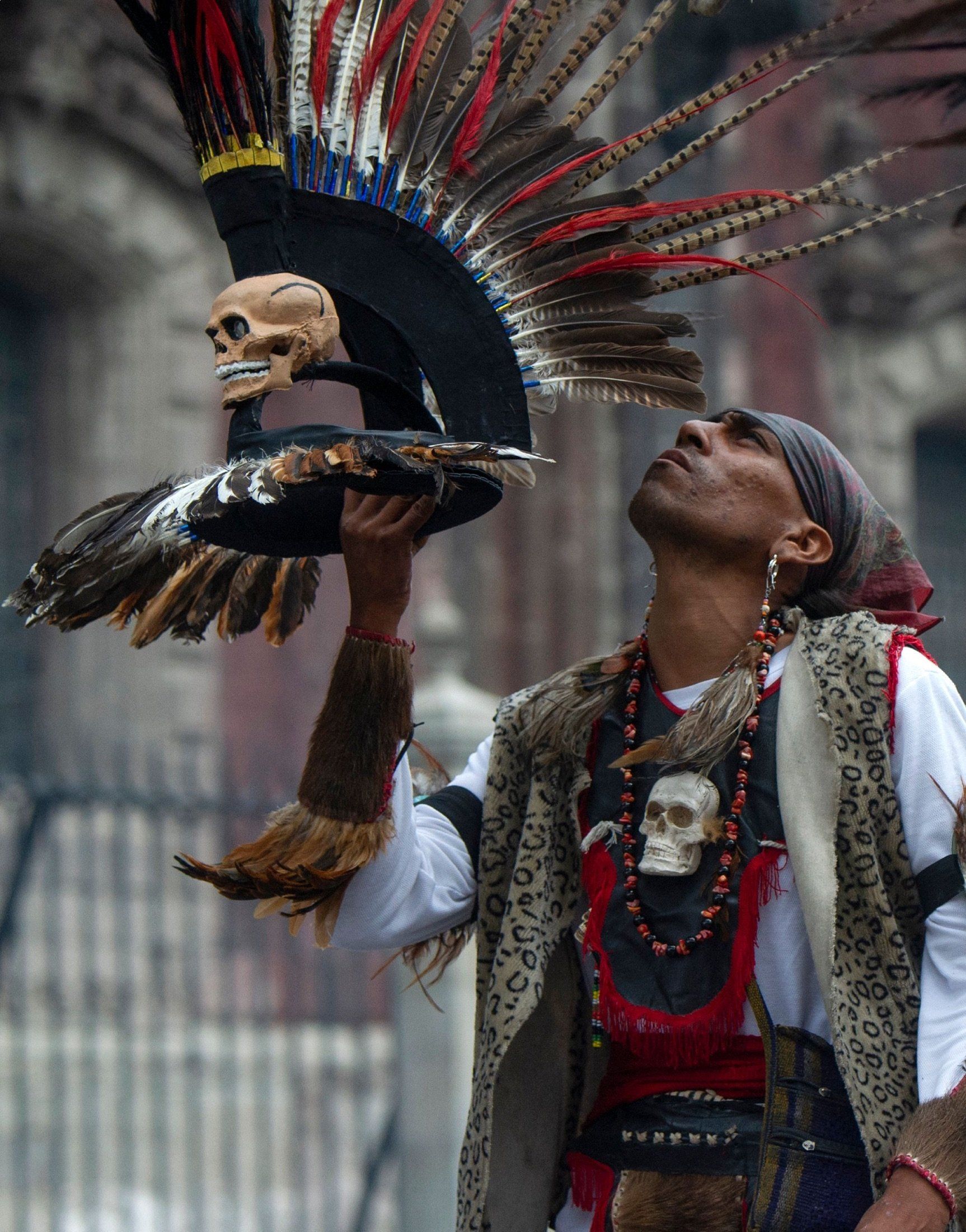 A man performs a ritual before an Aztec dance at the Zocalo square in Mexico City, Mexico, July 31, 2021. (AFP Photo)