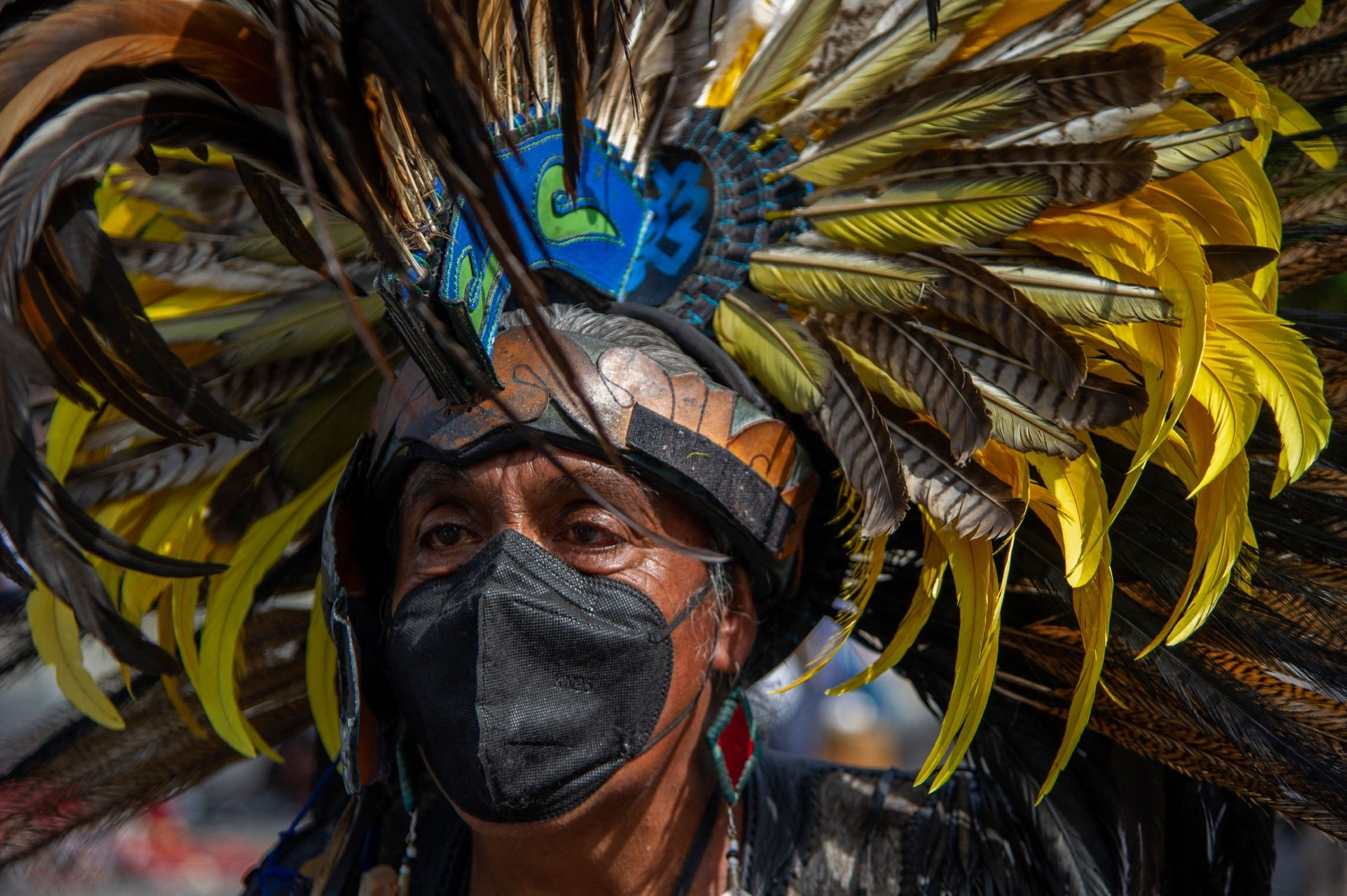 A man wears a Penacho before performing an Aztec dance at the Zocalo square in Mexico City, Mexico, July 31, 2021. (AFP Photo)