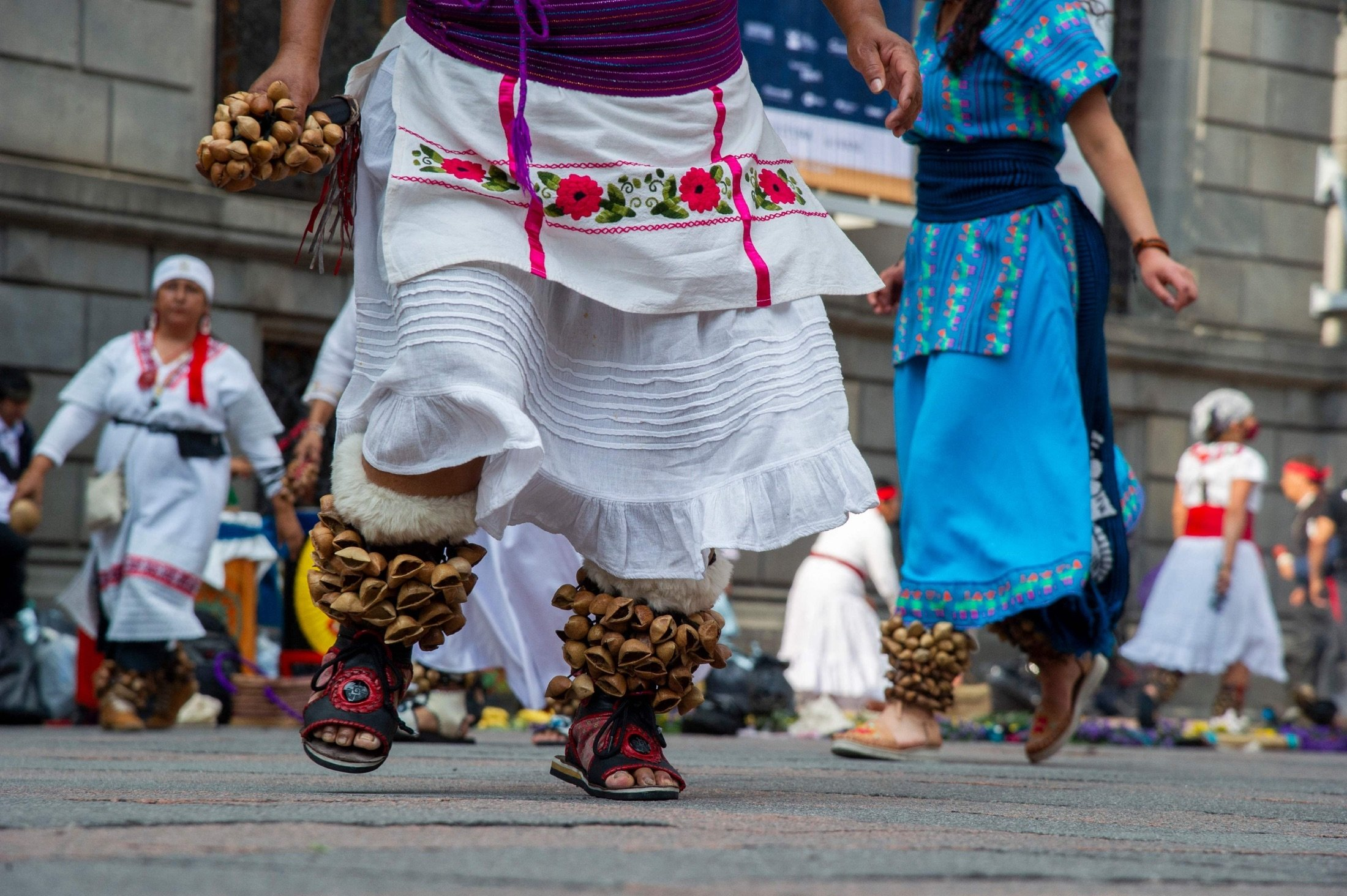 People perform an Aztec dance at the historical Center in Mexico City, Mexico, July 31, 2021. (AFP Photo)