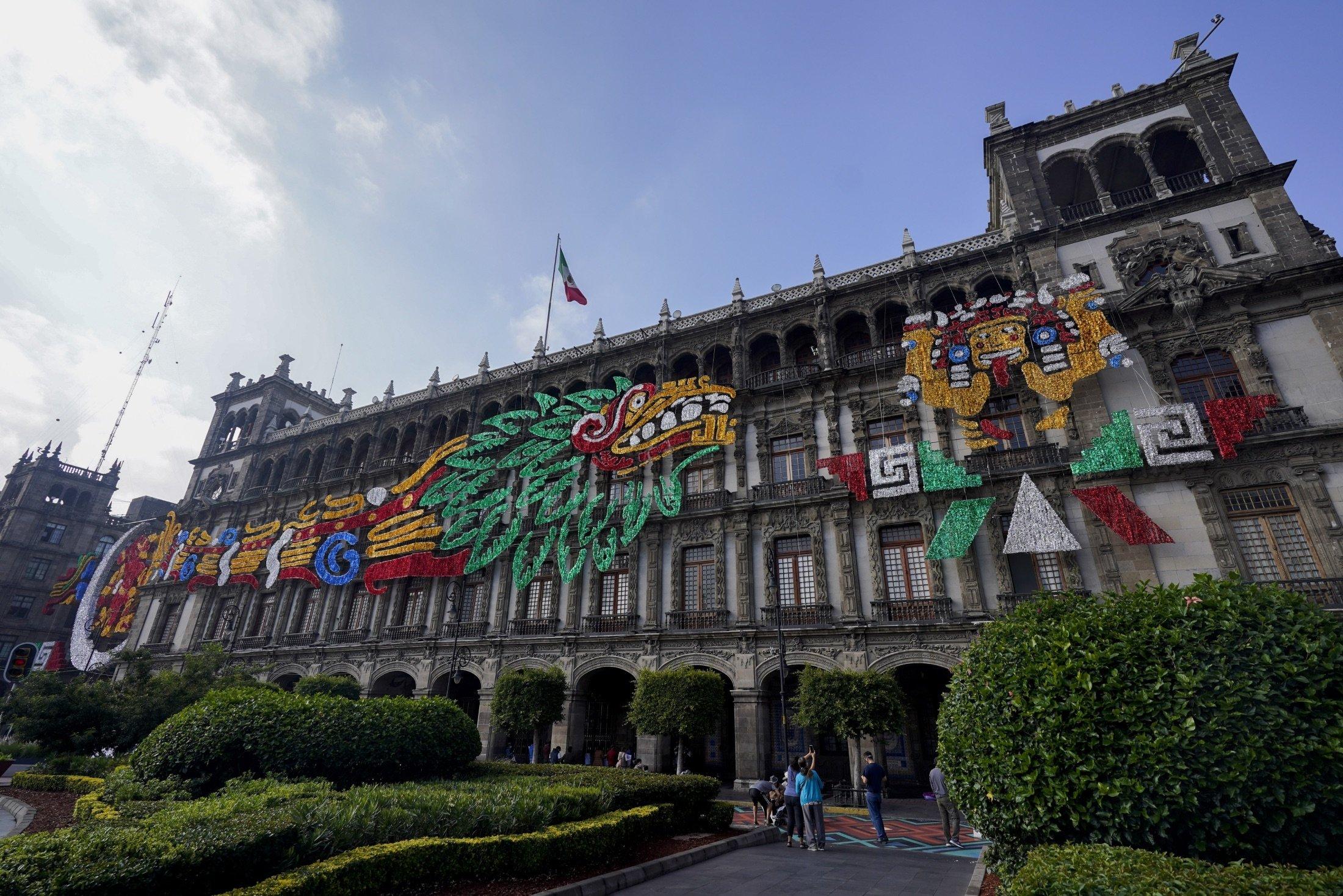 An image of the Pre-Columbian god Quetzalcoatl adorns a building at Mexico City´s main square the Zocalo, Mexico, Aug. 9, 2021. (AP Photo)