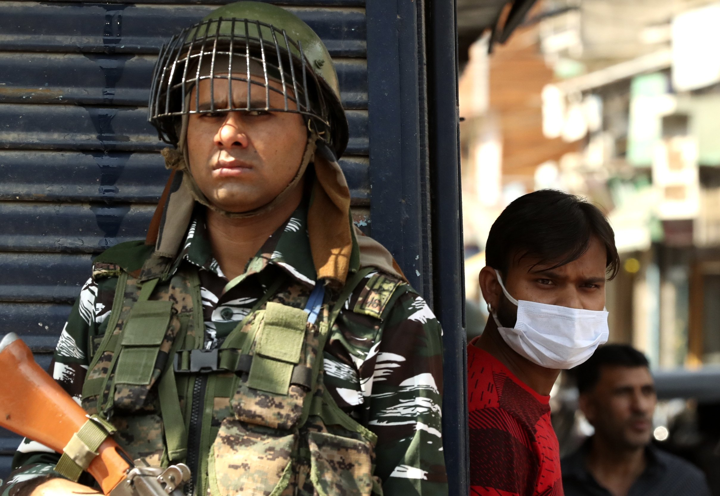 An Indian paramilitary soldier keeps guard near the site of a grenade attack at a busy market in Srinagar, Indian controlled Kashmir, Tuesday, Aug. 10, 2021. (AP Photo)