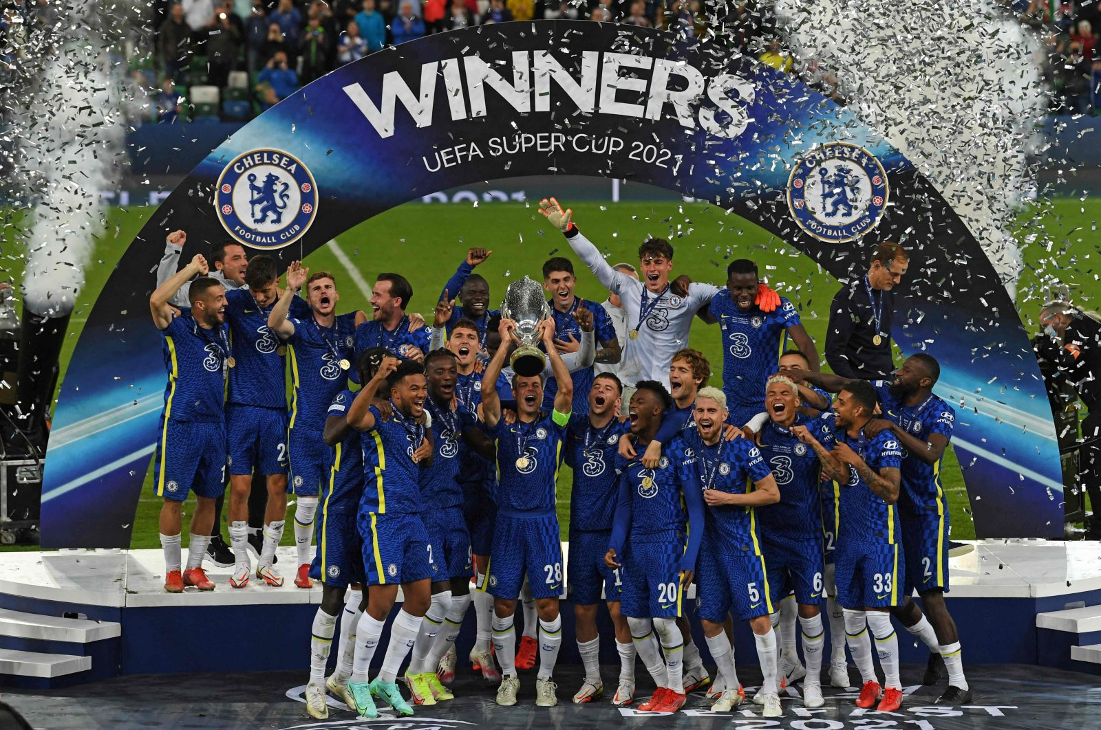 Chelsea's Spanish defender Cesar Azpilicueta (C) raises the trophy after Chelsea won the UEFA Super Cup match against Villarreal at Windsor Park in Belfast, Aug. 11, 2021. (AFP Photo)