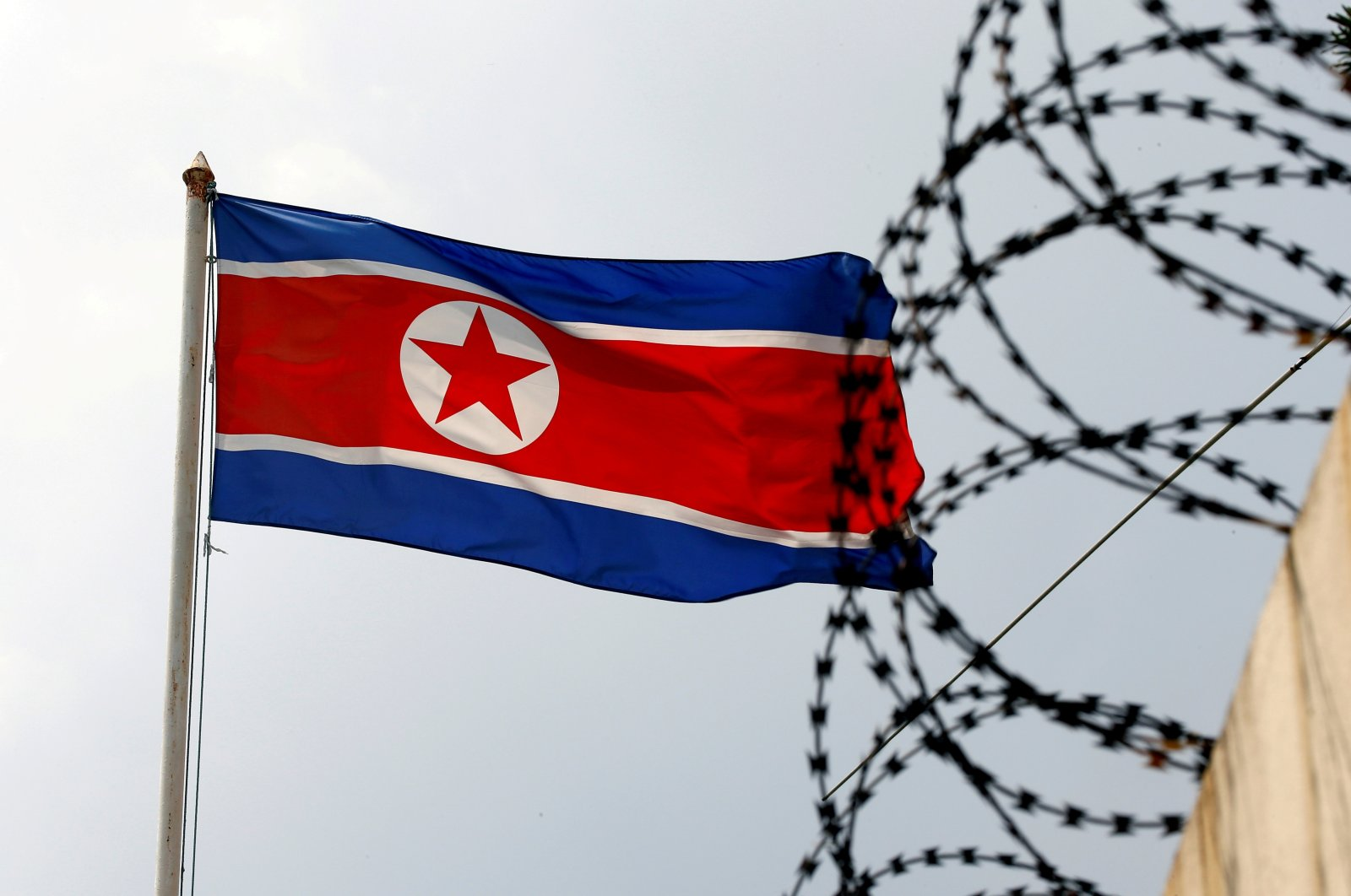 North Korea's flag flutters next to barbed wire at the North Korean Embassy in Kuala Lumpur, Malaysia, March 9, 2017. (Reuters Photo)