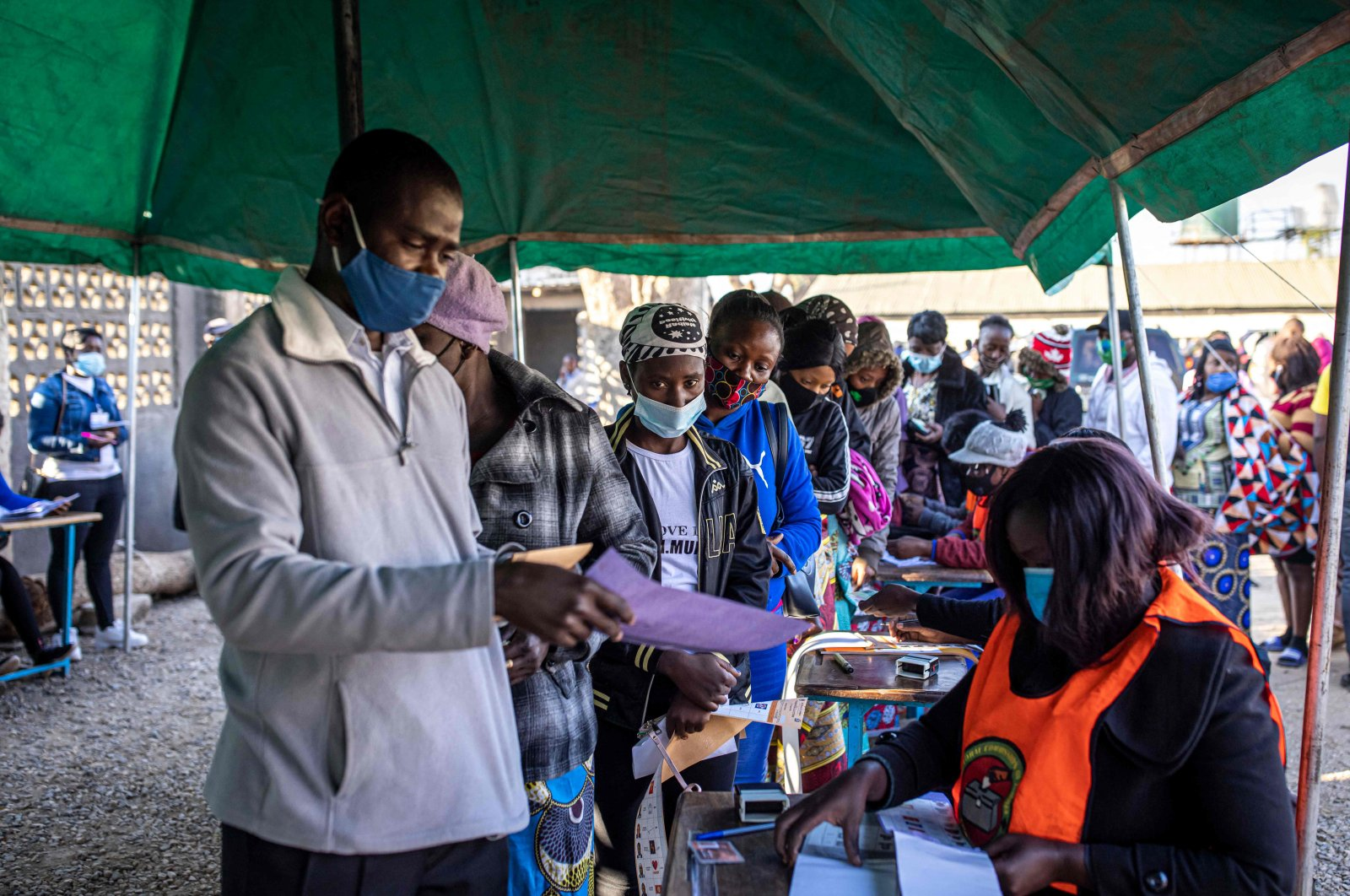 People queue at a polling station as Zambians elect their next president after a tense campaign, Lusaka, Zambia, Aug. 12, 2021. (AFP Photo)