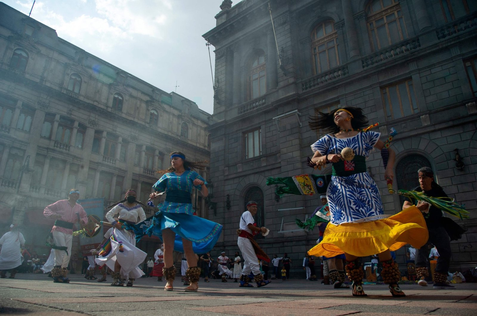 People perform an Aztec dance at the historical Center in Mexico City, Mexico, Aug. 3, 2021. (AFP Photo)