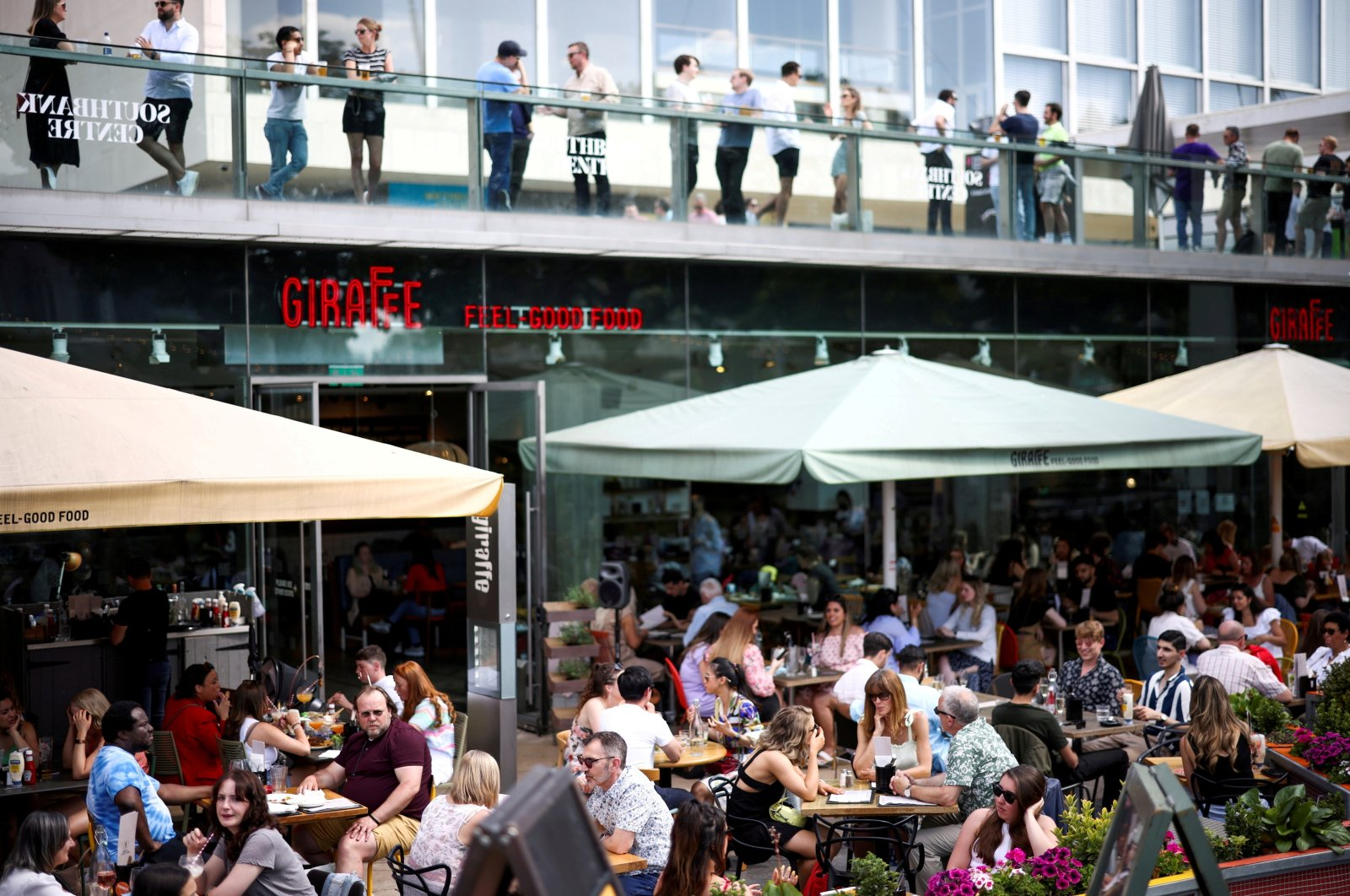 People sit at an outdoor restaurant on the South Bank during sunny weather, amid a COVID-19 outbreak, in London, Britain, June 5, 2021. (Reuters Photo)