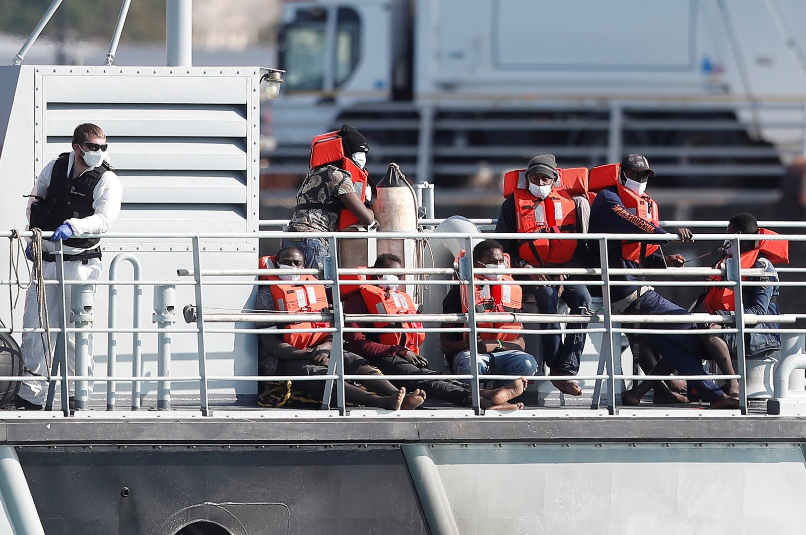 Migrants claiming to be from Darfur, Sudan sit on a Border Force vessel after being rescued as they crossed the English Channel in an inflatable boat near Dover, Britain, August 4, 2021. (Reuters Photo)