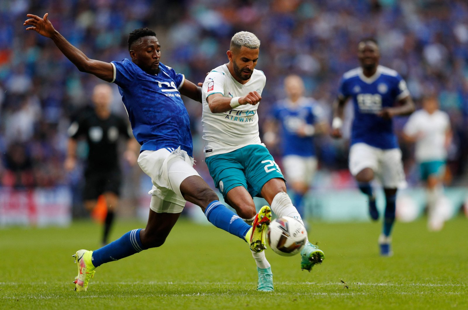 Manchester City's Algerian midfielder Riyad Mahrez (R) tries to shoot past Leicester City's Wilfred Ndidi (L) during the English FA Community Shield match at Wembley Stadium, London, England, Aug. 7, 2021. (AFP Photo)