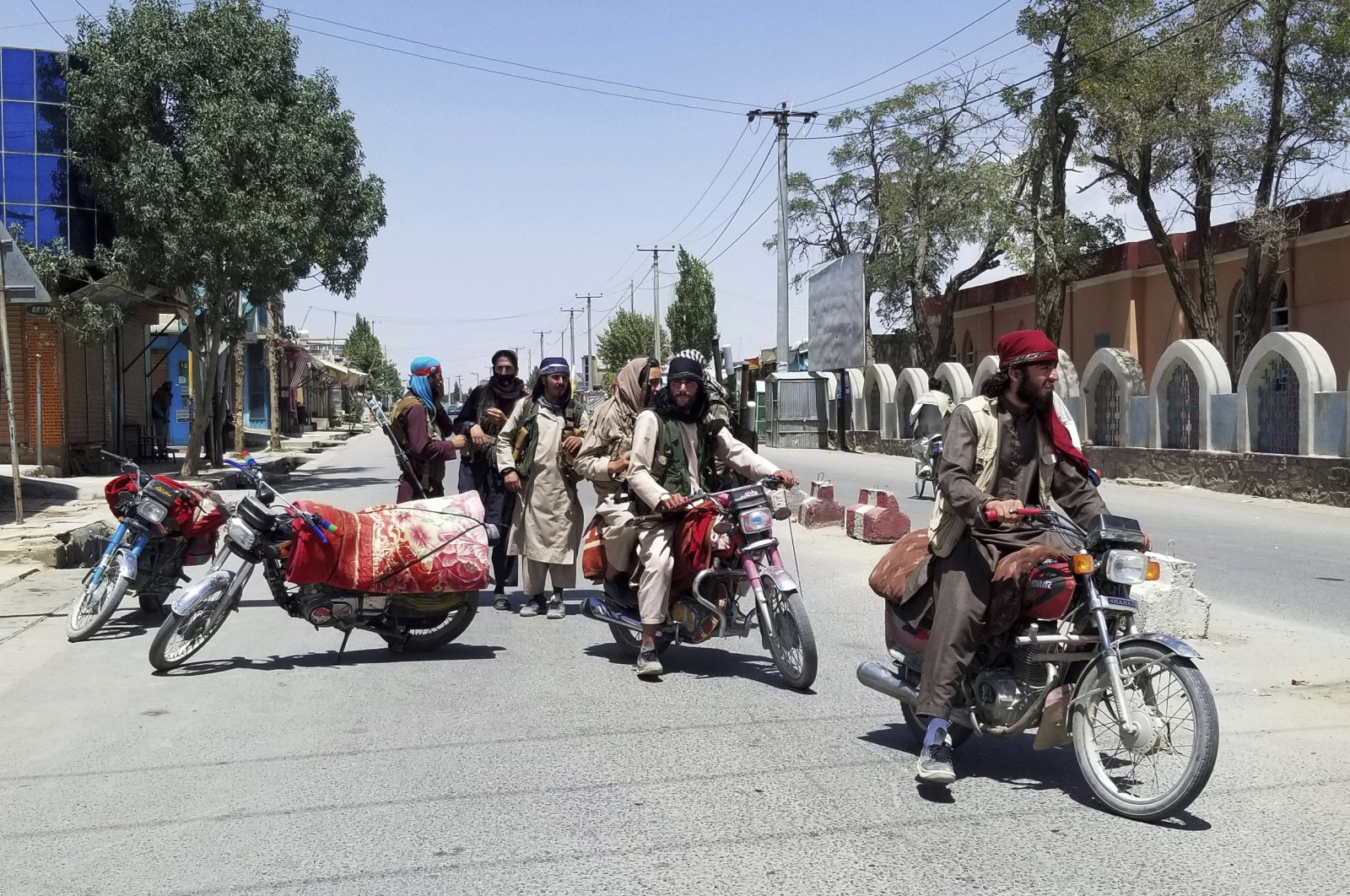 Taliban fighters patrol inside the city of Ghazni, southwest of Kabul, Afghanistan, Aug. 12, 2021. (AP Photo)