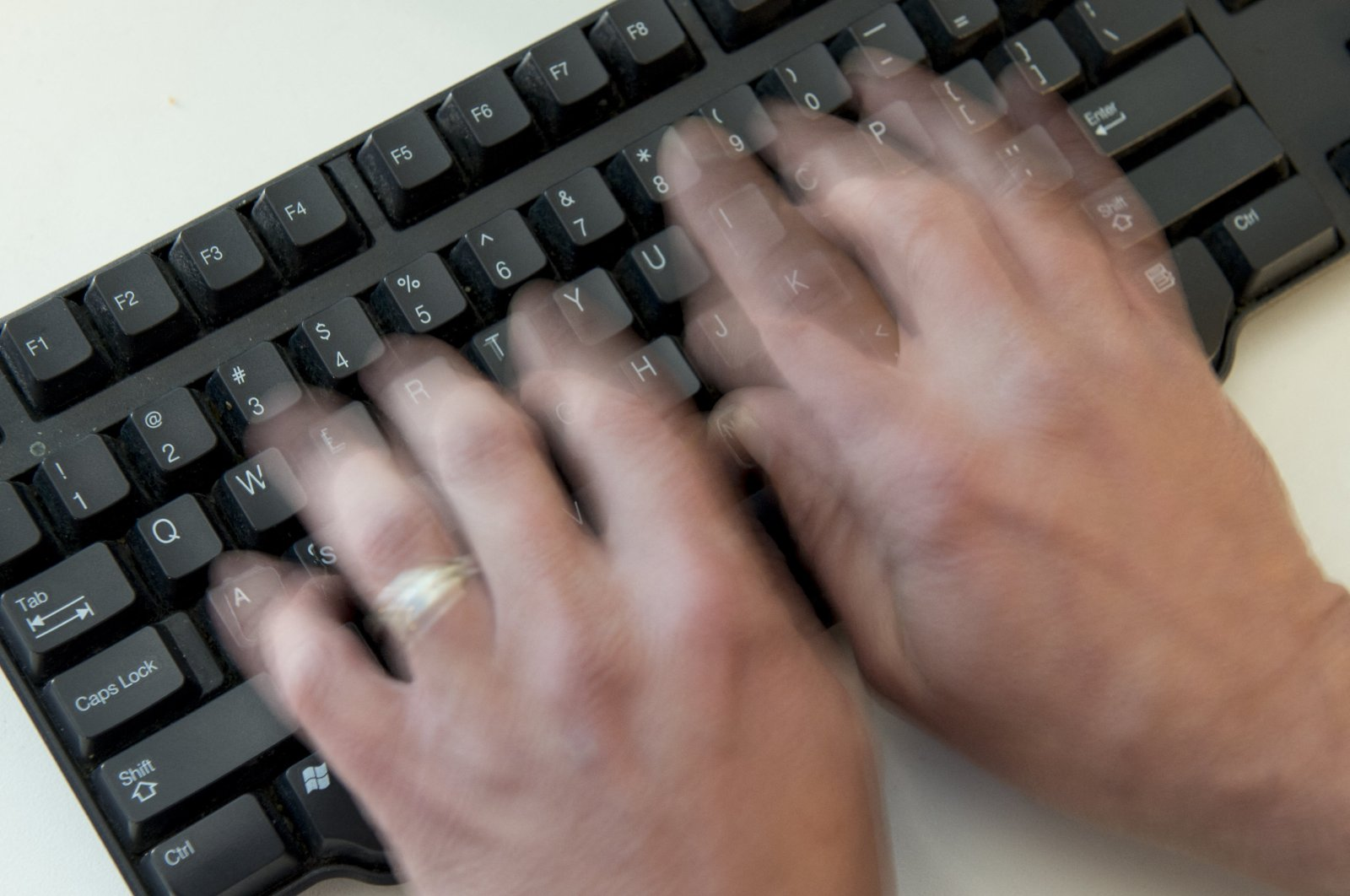 A person types on a computer keyboard, in Washington, D.C., U.S., Nov. 21, 2016. (AFP Photo)