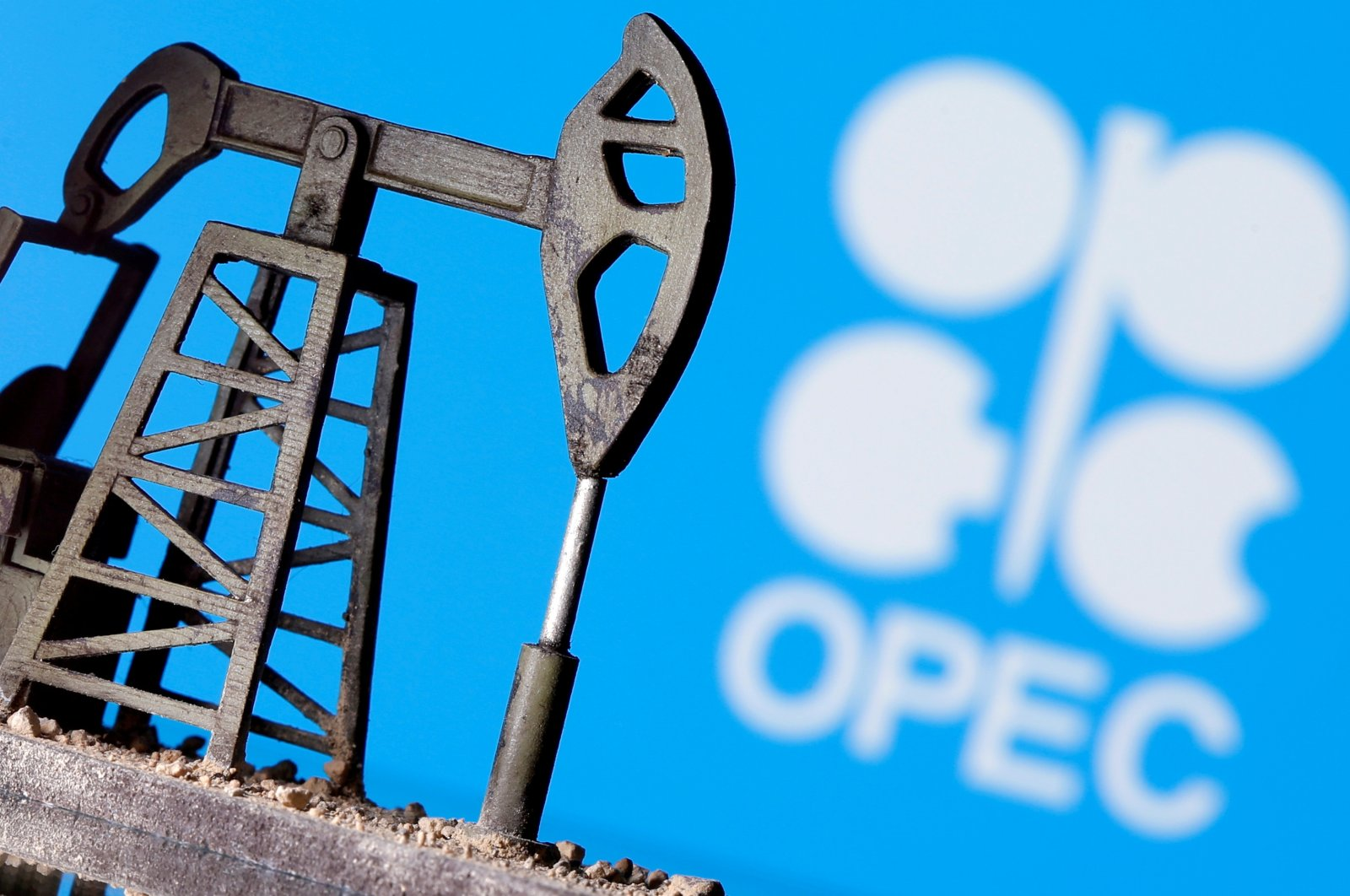 A 3D-printed oil pump jack is seen in front of displayed OPEC logo in this illustration picture, April 14, 2020. (Reuters Photo)