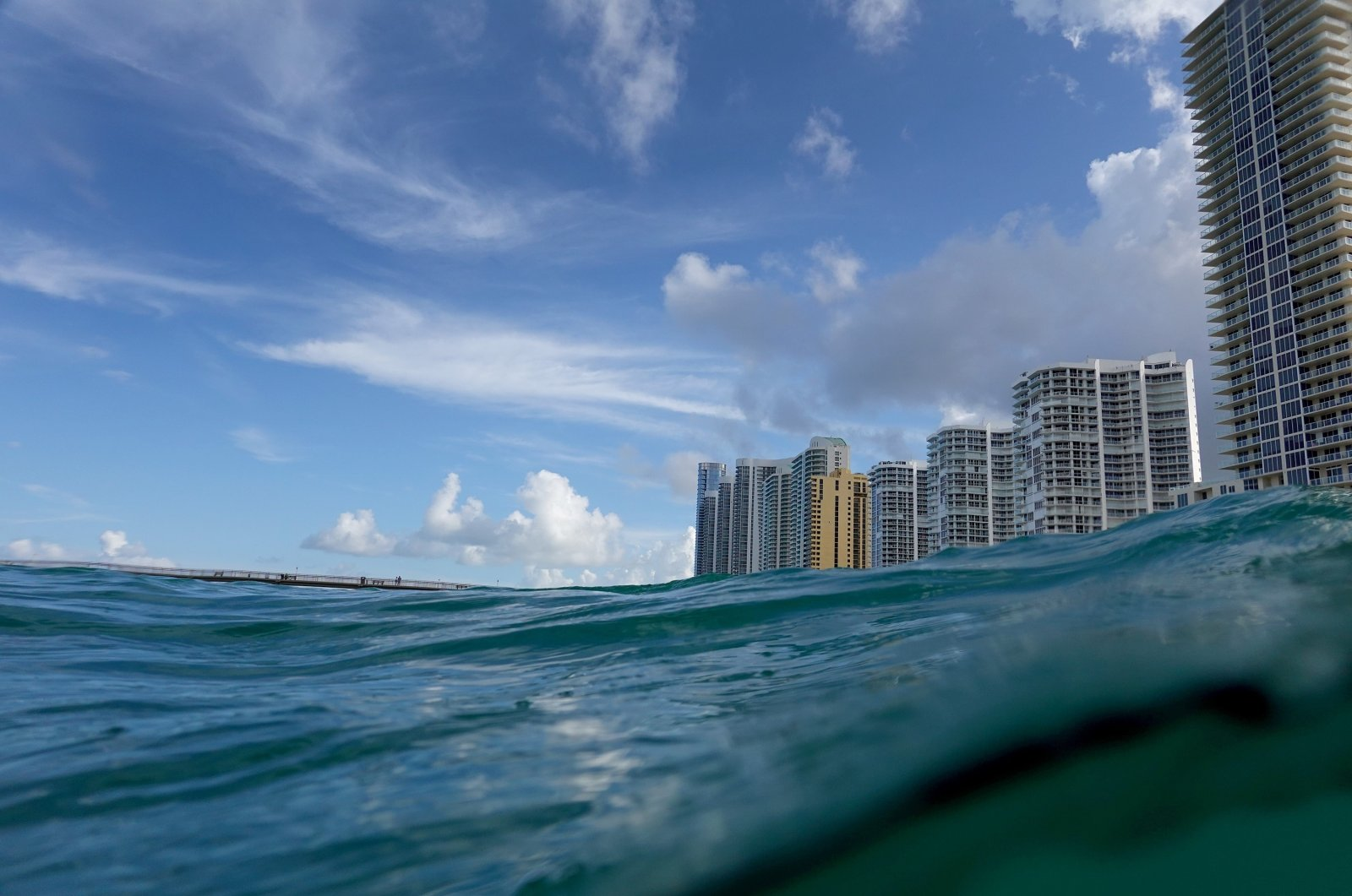 Waves lap ashore near condo buildings on the day the United Nations released a report with a dire warning for humanity in Sunny Isles, Florida, U.S., Aug. 9, 2021. (AFP Photo)