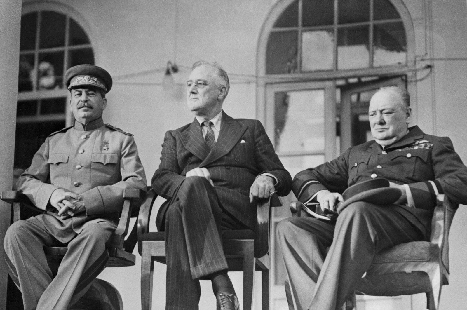 Soviet Union leader Josef Stalin (L), U.S. President Franklin Roosevelt (C) and U.K. Prime Minister Winston Churchill confer in the Soviet Embassy during the Tehran Conference, Tehran, Iran, Dec. 7, 1943. (Getty Images)
