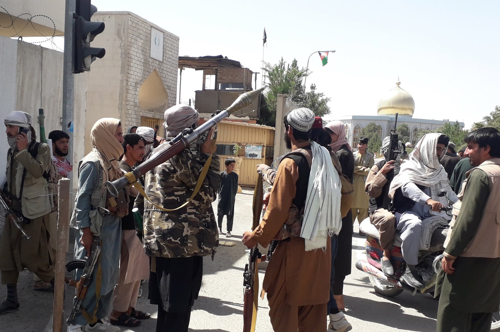 Taliban militants patrol after taking control of the governor's house and Ghazni city, in Afghanistan, Aug. 12, 2021. (EPA Photo)