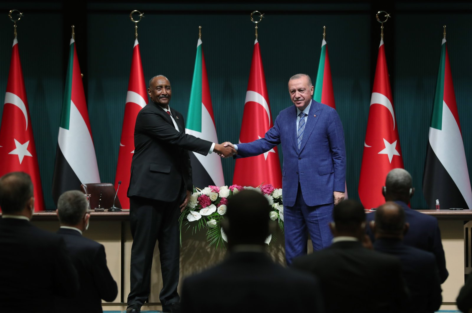 President Recep Tayyip Erdoğan (R) shakes hands with Abdel Fattah al-Burhan, the chairperson of Sudan's Sovereign Council, following their meeting in the capital Ankara, Turkey, Aug. 12, 2021. (AA Photo)