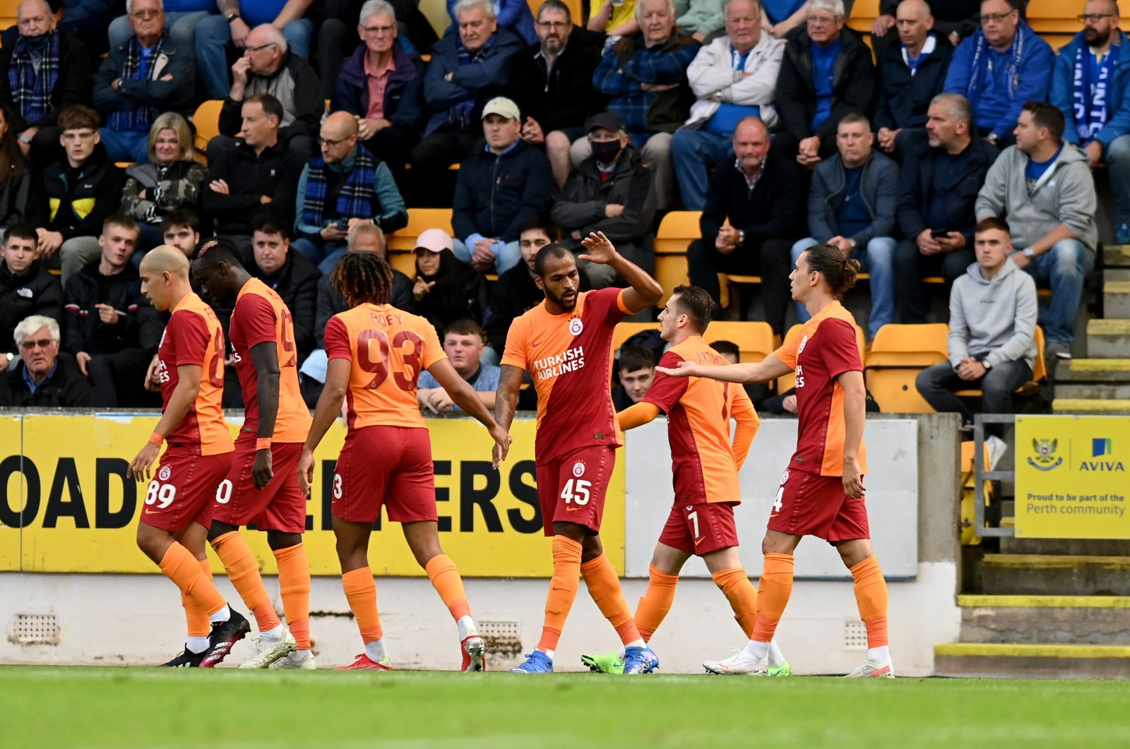 Galatasaray players celebrate after scoring a goal at Scotland's McDiarmid Park during the UEFA Europa League third qualifying round, Aug. 12, 2021 (AA Photo)