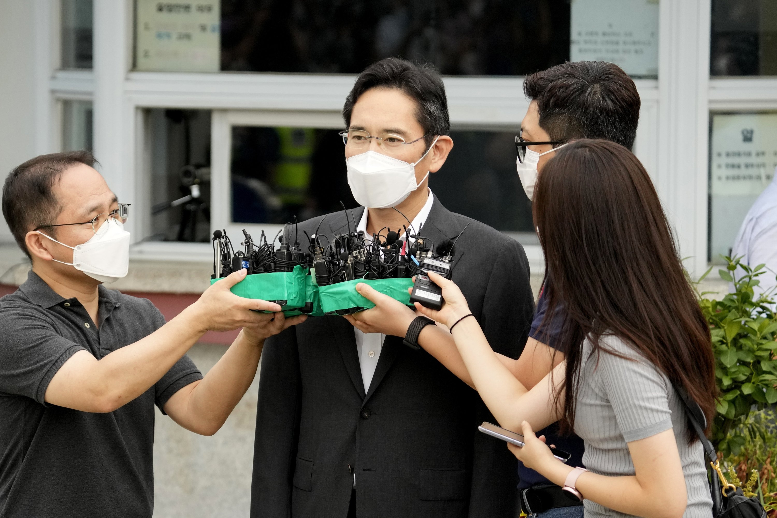 Lee Jae-yong, vice chairperson for Samsung Electronics, speaks to the media outside of a detention center in Uiwang, South Korea, Aug. 13, 2021. (AP Photo)