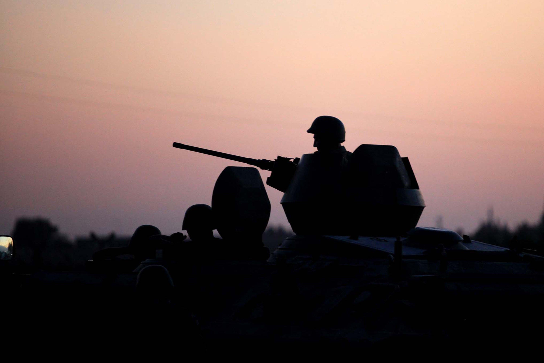 Turkish security forces stand near the Turkey-Syria border in Akçakale, Turkey, Oct. 5, 2012. (AP Photo)