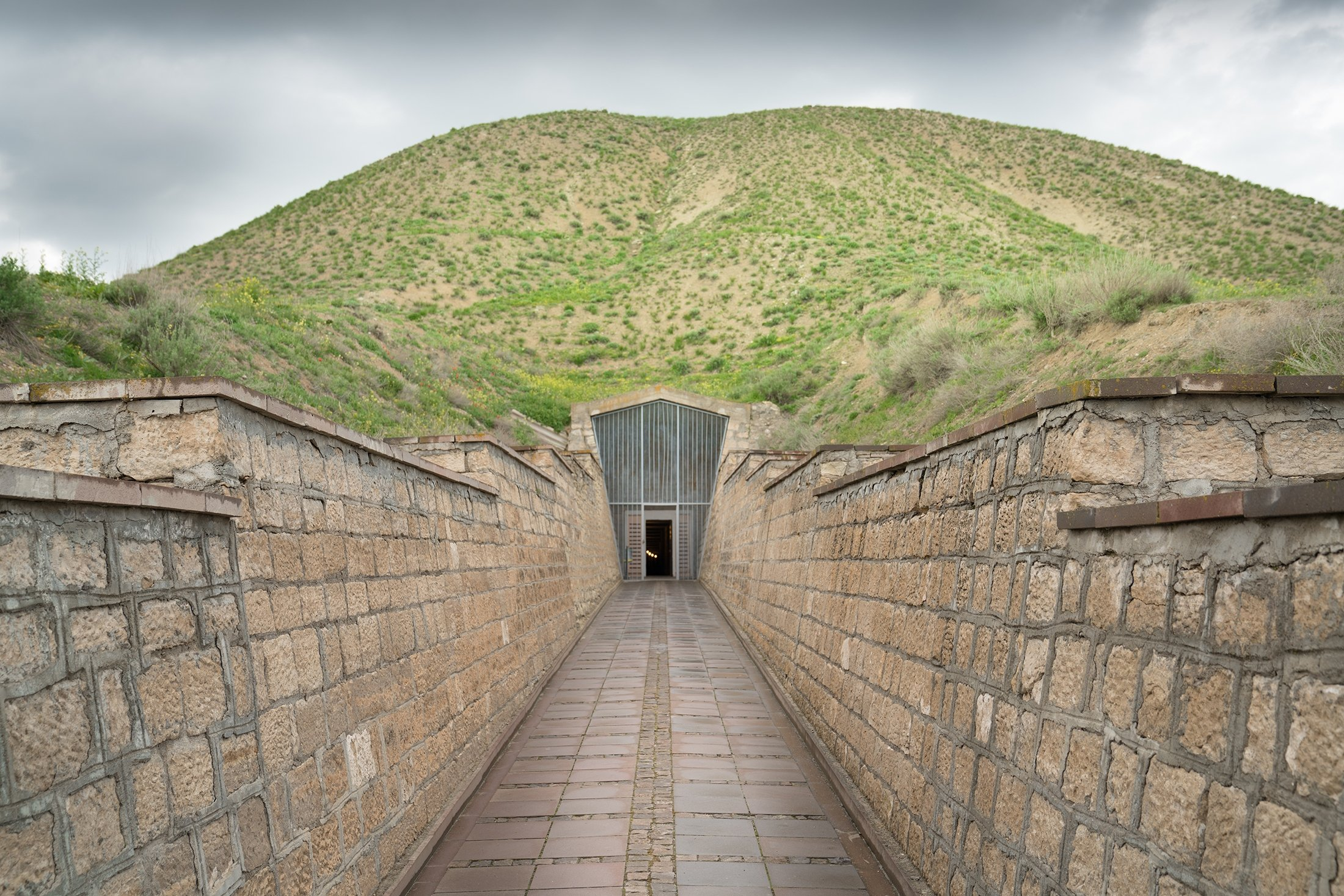 The tumulus and entrance to the tomb of King Midas of Phrygia in the ancient city of Gordion, Ankara, Turkey. (Shutterstock Photo)