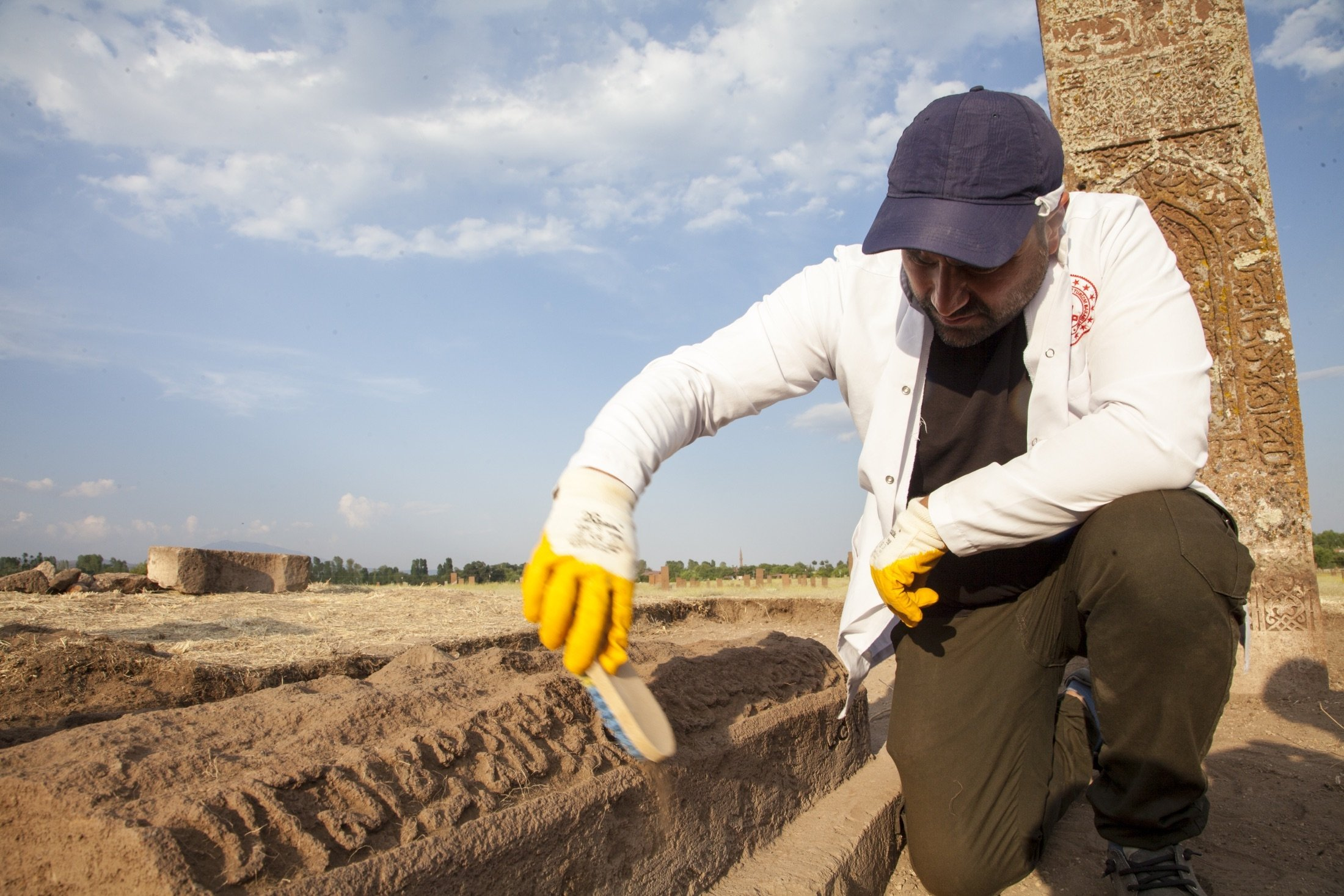 Member of the excavation team carries out archaeological work at an unidentified Seljuk grave