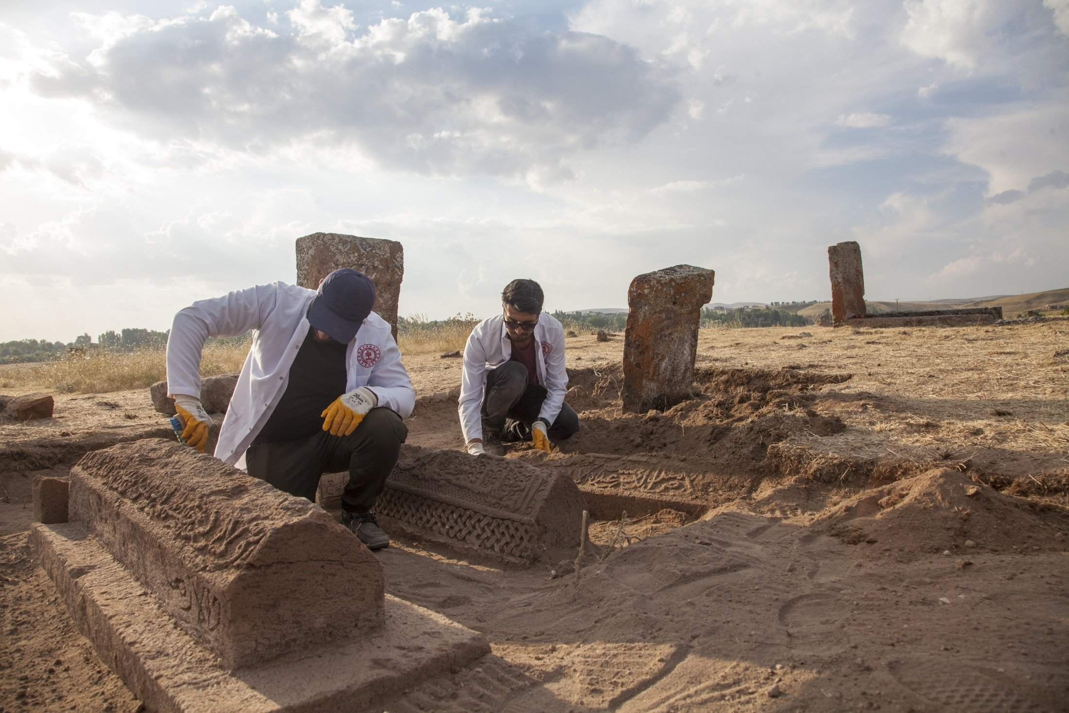 Members of the excavation team carry out archaeological work at unidentified Seljuk graves