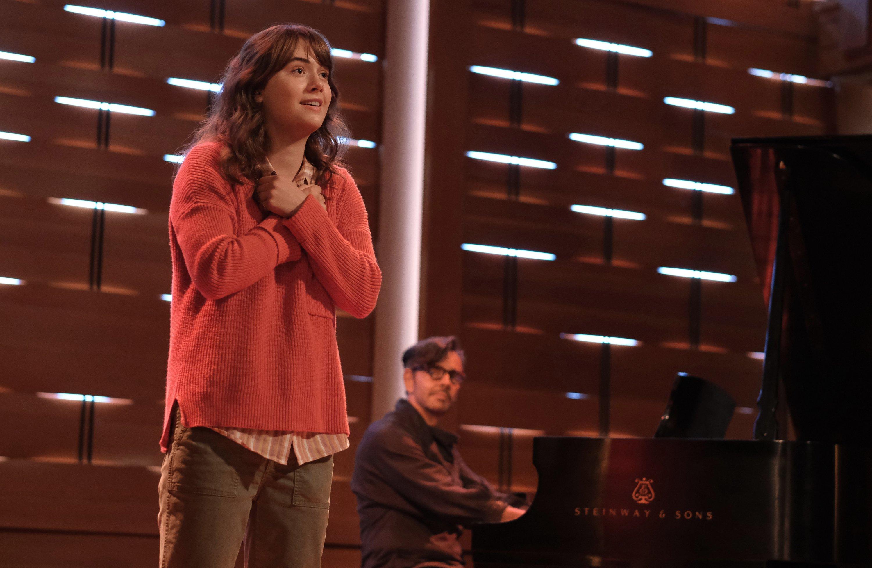 "Emilia Jones (L)and Eugenio Derbez on a stage, in a scene from the film ""CODA."" (Apple TV+ via AP)"