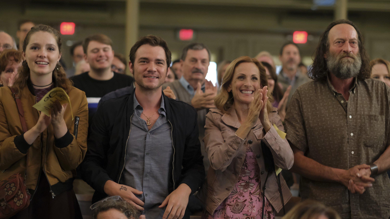 "Amy Forsyth (L), Daniel Durant (C-L), Marlee Matlin (C-R) and Troy Kotsur applaud, in a scene from the film ""CODA."" (Apple TV+ via AP)"