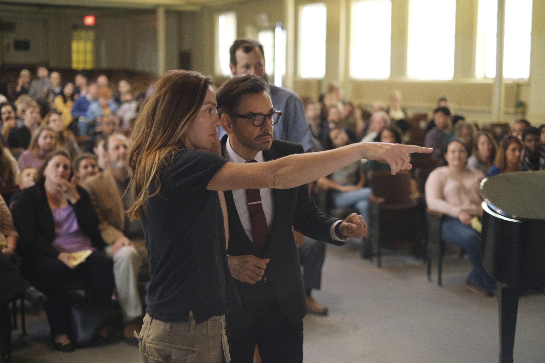 "DirectorSian Heder (L) talks with actorEugenio Derbez, on the set of the film ""CODA.""(Apple TV+ via AP)"