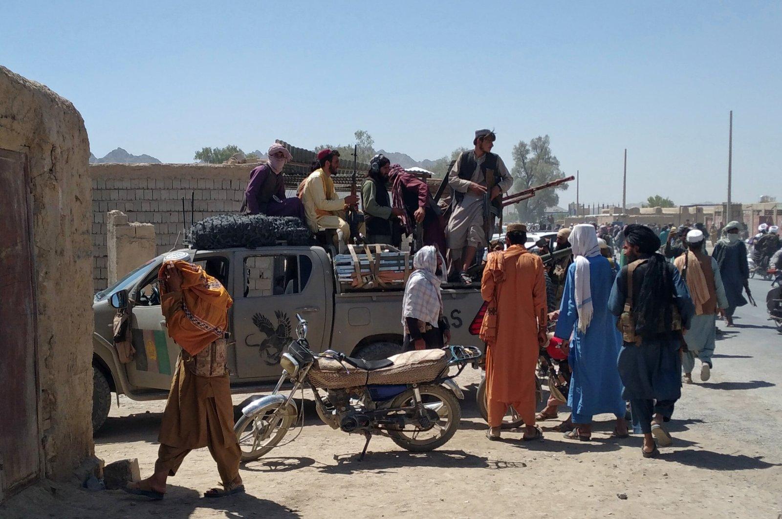 Taliban fighters patrol inside the city of Farah, capital of Farah province, southwest Afghanistan, Aug. 11, 2021. (AP Photo)