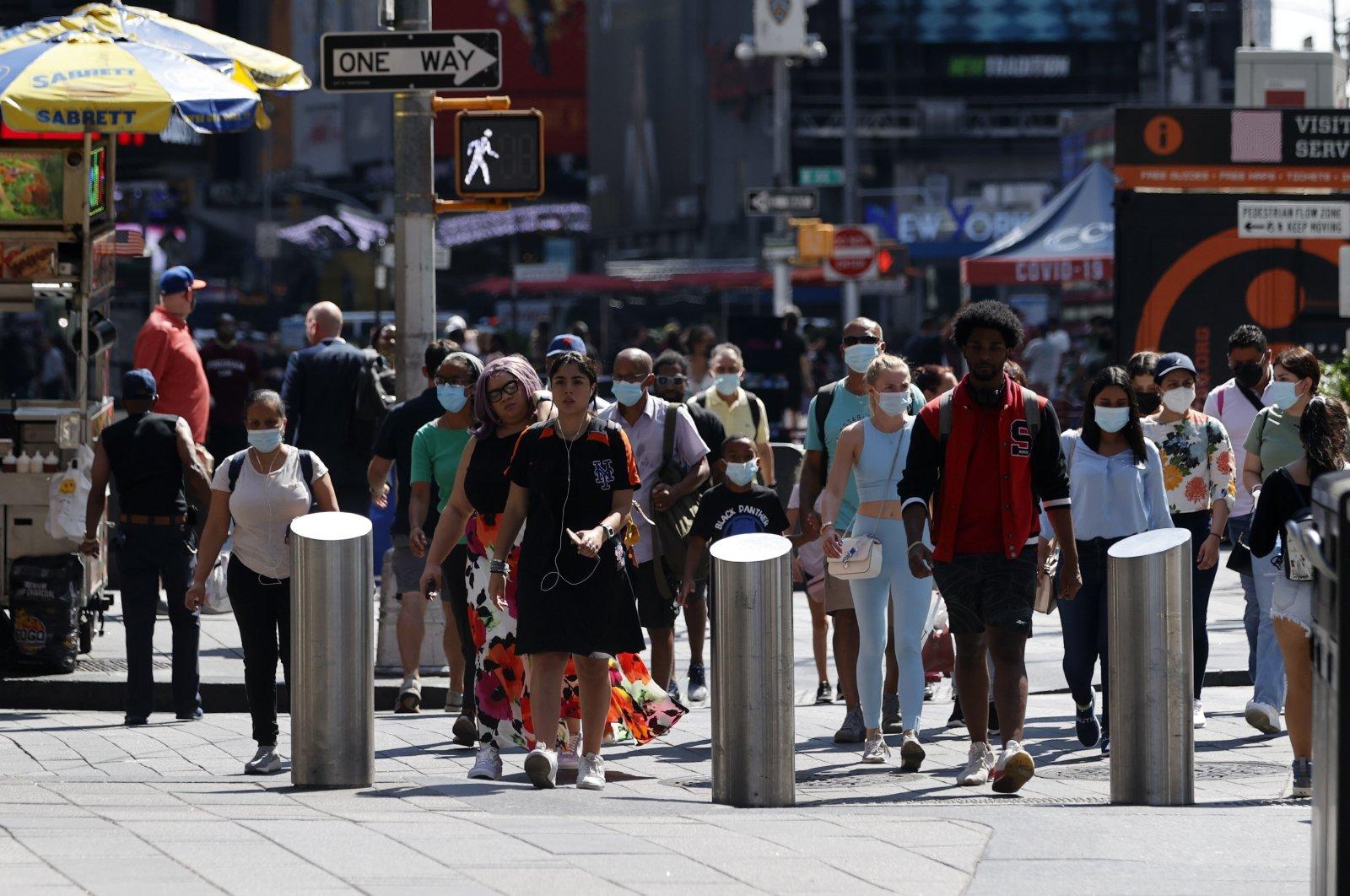 People walk through Times Square in New York, U.S., Aug. 12, 2021. (EPA Photo)