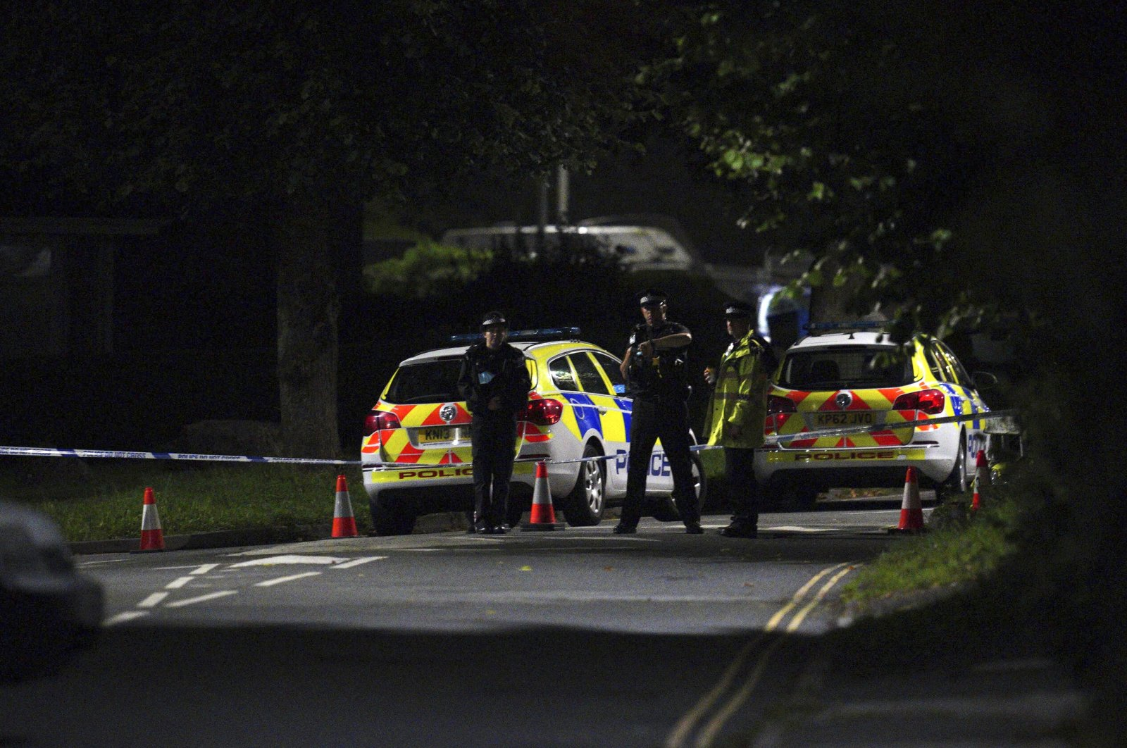 Emergency services are seen near the scene of the shooting on Biddick Drive, in the Keyham area of Plymouth, southwest England, Aug. 12, 2021. (AP Photo)