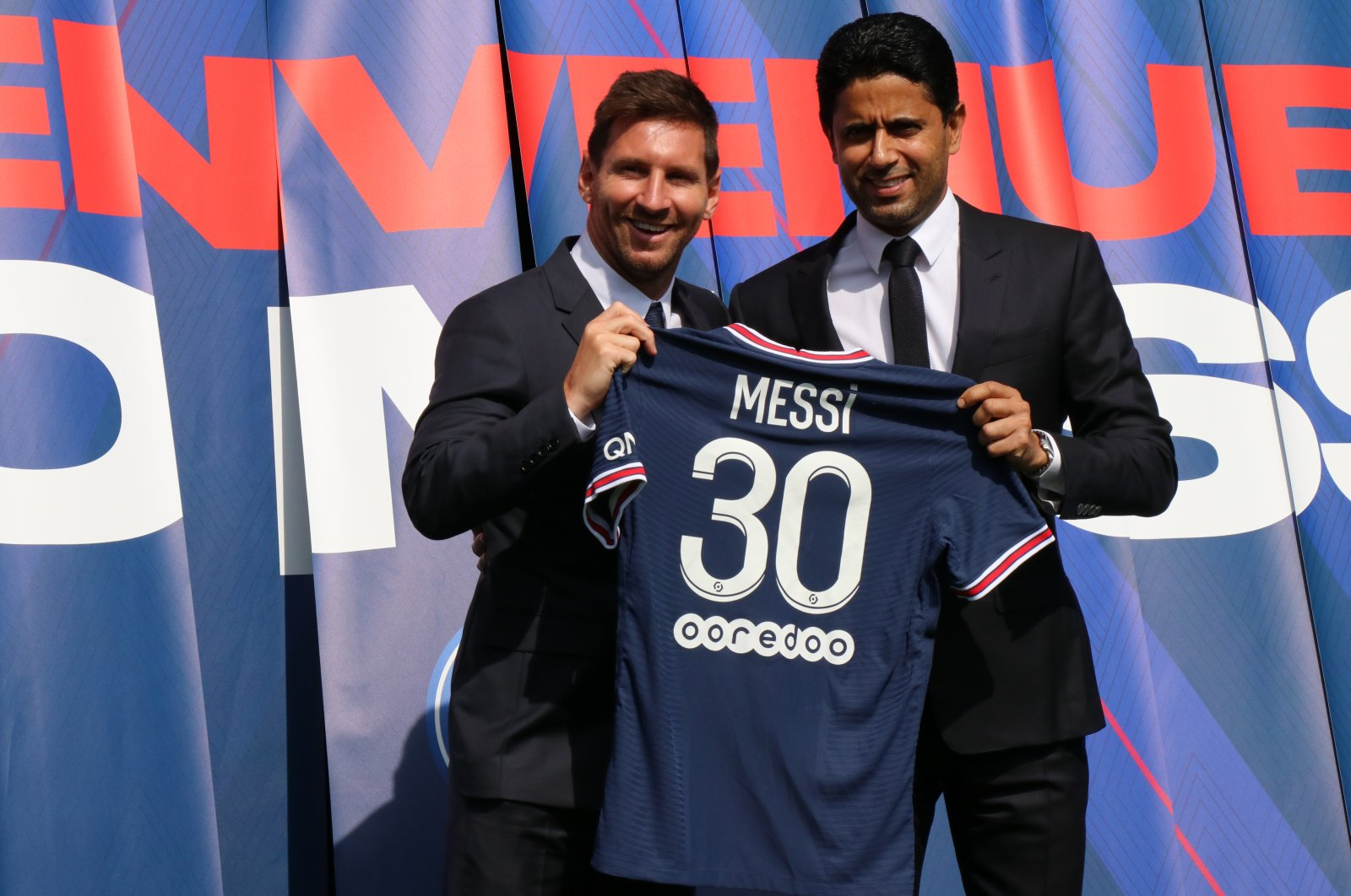 Lionel Messi holds a jersey as he poses next to PSG Chairperson Nasser al-Khelaifi (R), in Paris, France, Aug. 11, 2021. (AA PHOTO)