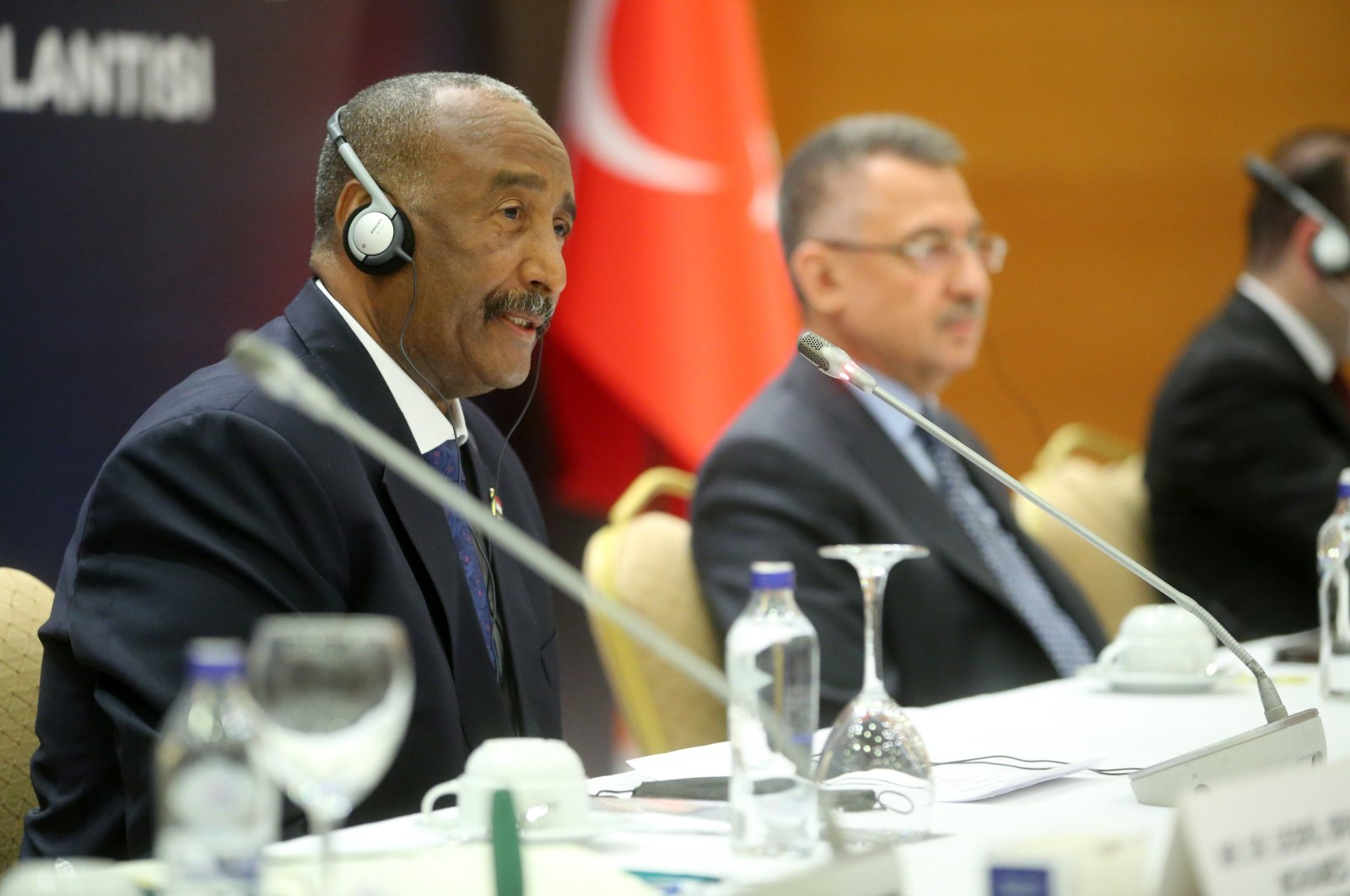 Abdel Fattah al-Burhan (L), the chairperson of Sudan's Sovereign Council and Vice President Fuat Oktay (R) during a meeting with businesspeople in Ankara, Aug. 13, 2021 (AA Photo)