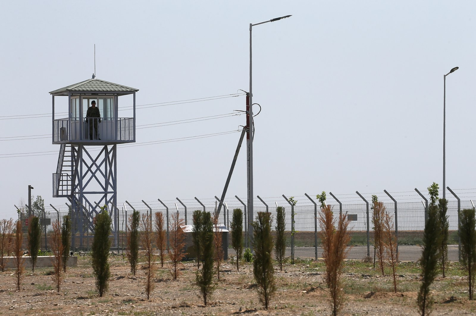 A serviceman stands guard on an observation tower at the Russian-Turkish center monitoring the cease-fire in Nagorno-Karabakh, Aghdam, Azerbaijan, July 5, 2021. (Getty Images)