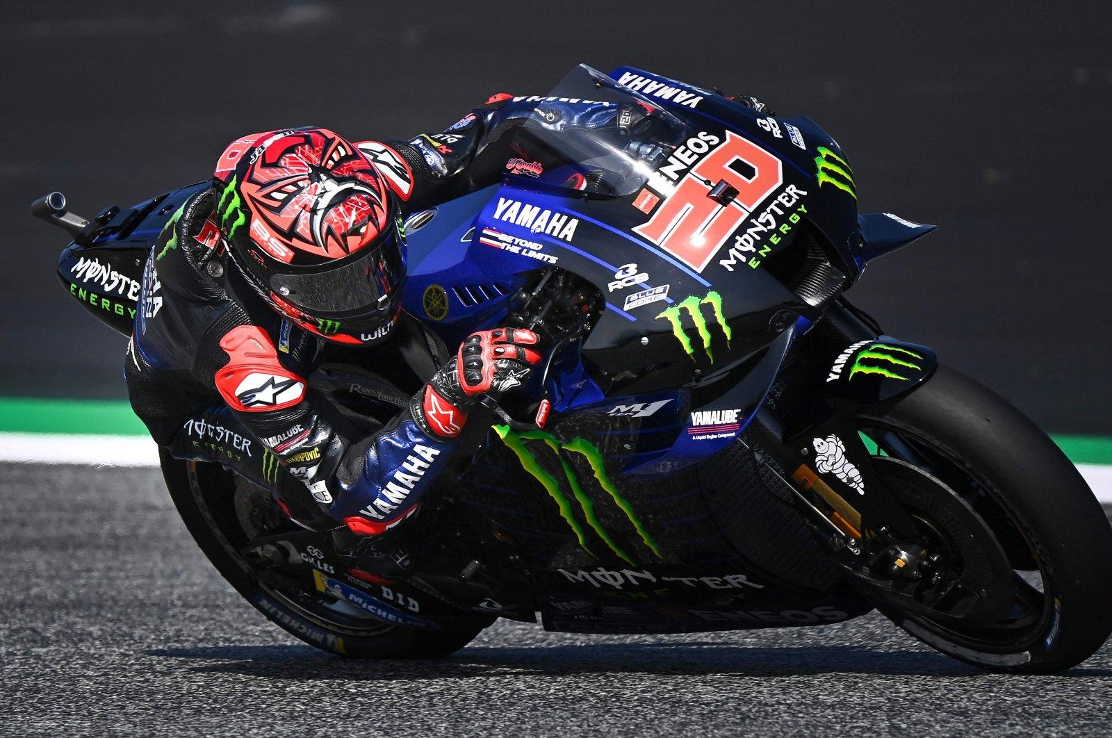 Fabio Quartararo steers his motorbike during the first free practice session ahead of Austrian MotoGP, in Spielberg, Austria, Aug. 13, 2021. (AFP PHOTO)