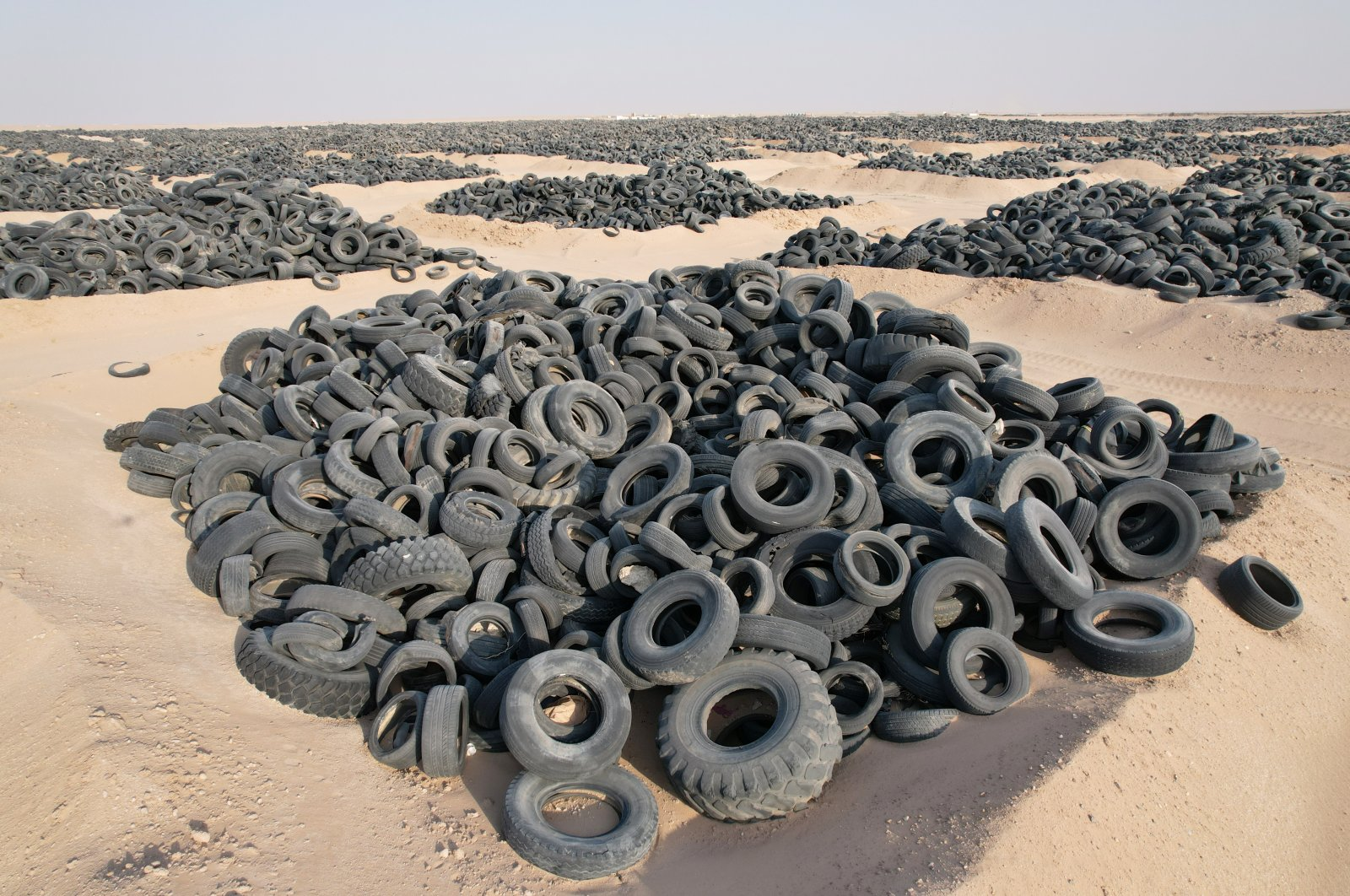 A tire graveyard with 50 million dumped tires poses environmental and health risks. (AA Photo)