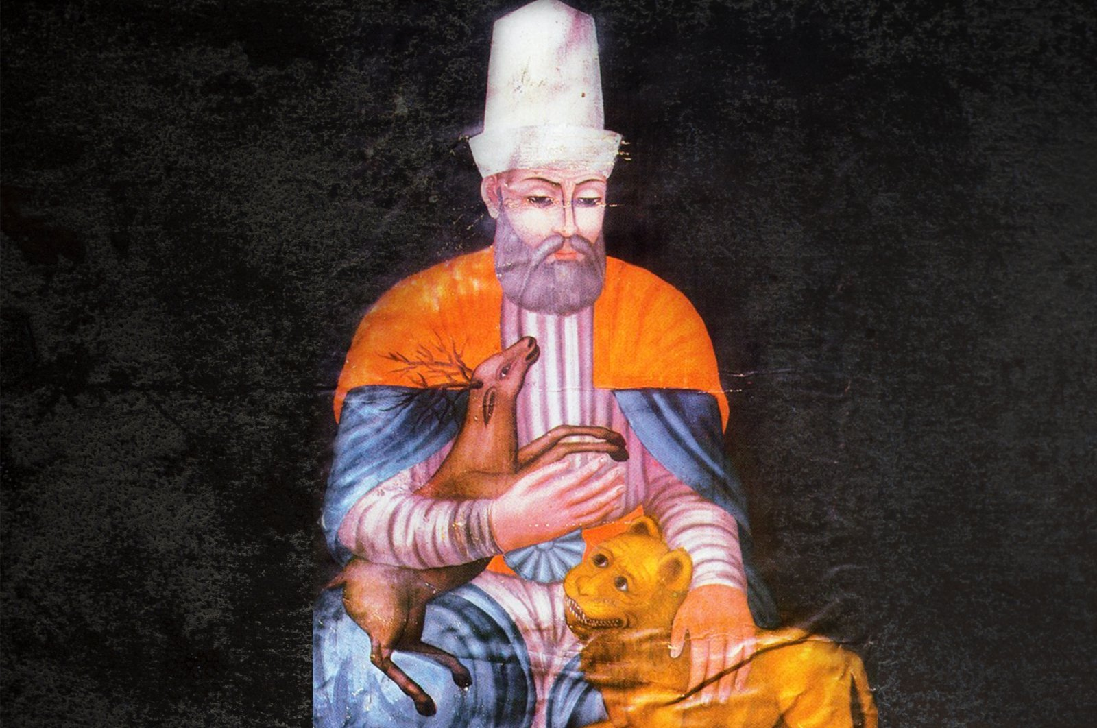 A general depiction of Haji Bektash Veli, holding a deer and a lion.