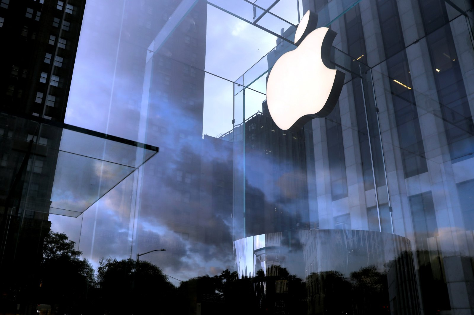 The Apple Inc. logo is seen hanging at the entrance to the Apple store on 5th Avenue in Manhattan, New York, U.S., on Oct. 16, 2019. (REUTERS Photo)