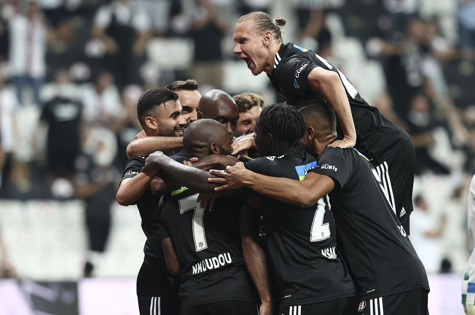 Beşiktaş club captain Atiba Hutchinson celebrates with his teammates after he scores the second goal for his team in a 3-0 win against Rizespor in the first match of the season at Vodafone Arena, Istanbul, Turkey, Aug. 13, 2021. (AA Photo)
