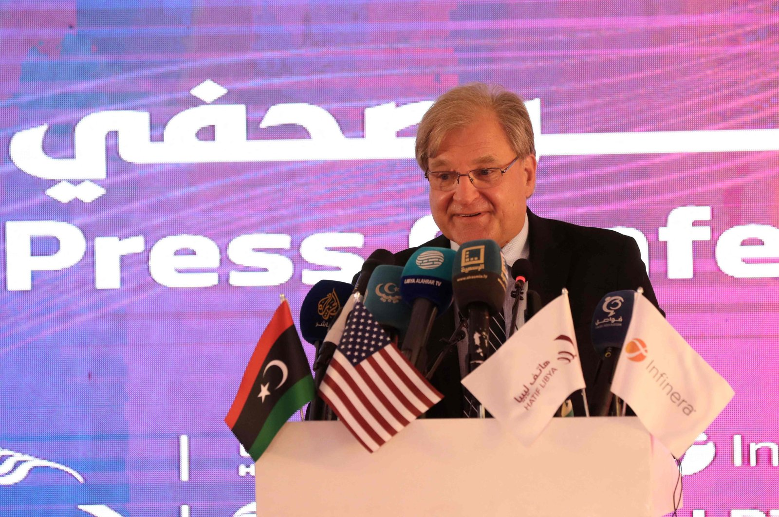 US Ambassador to Libya Richard Norland speaks after the US  Infinera and Hatif Libya companies signed an agreement to develop the national network of communication in Libya's capital Tripoli on July 26, 2021. (AFP Photo)