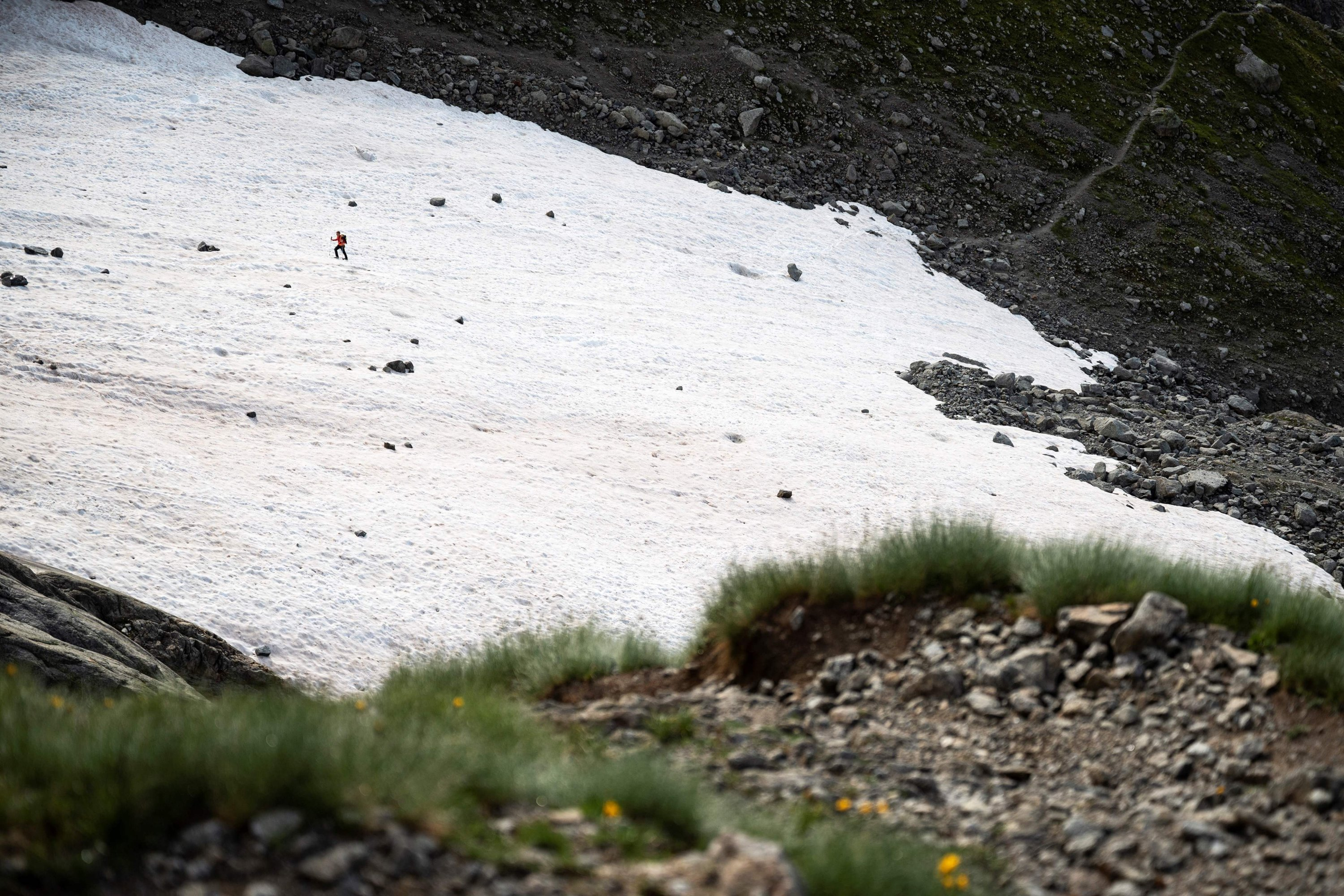 An alpinist walks on a snowfield on the path to the Boccalatte Hut in Courmayeur, Alps Region, north-western Italy, Aug. 5, 2021. (AFP Photo)