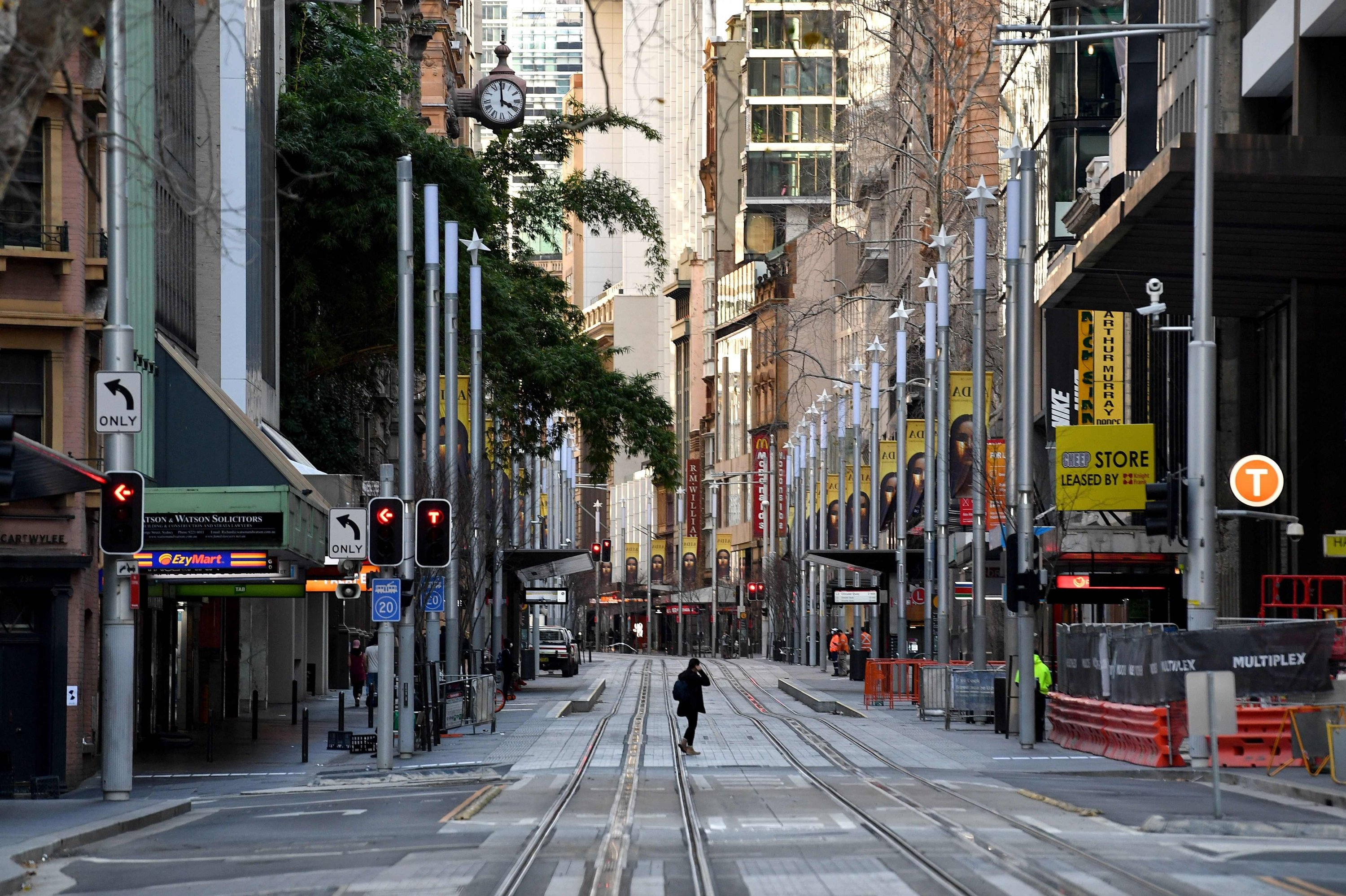 A general view shows a quiet street in the central business district of Sydney as Australia's biggest city announced tighter COVID-19 restrictions to contain a delta outbreak, Sydney, Australia, Aug. 14, 2021. (AFP Photo)