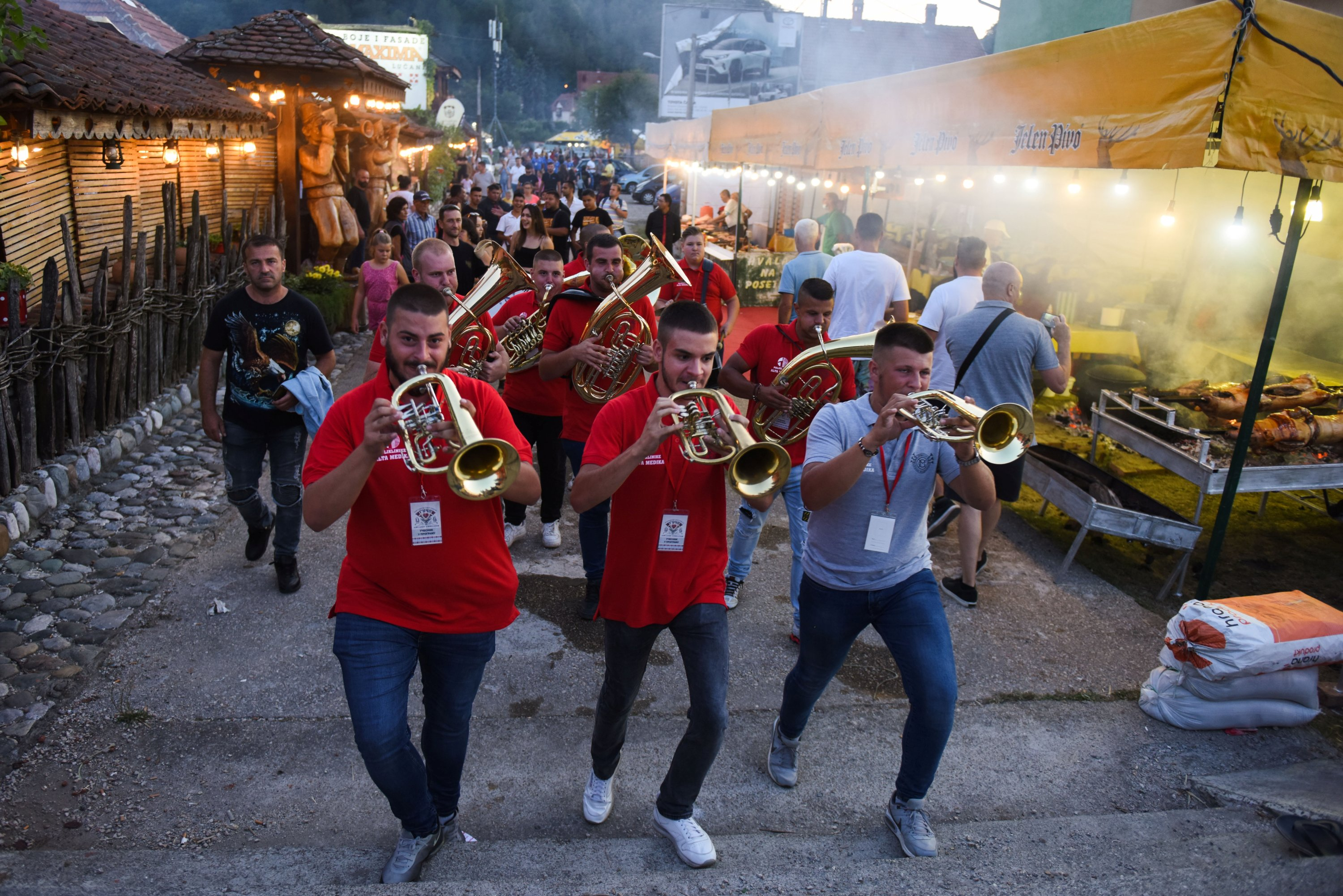 Musicians play their instruments during the annual brass band festival in Guca, Serbia, Aug. 13, 2021. (Reuters Photo)