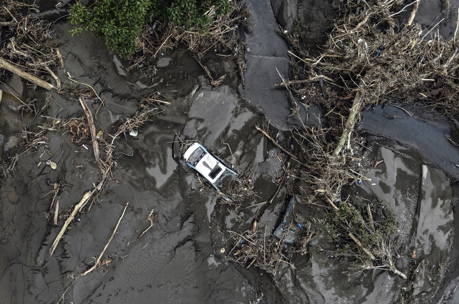 An aerial photo shows the destruction after floods and mudslides killed about three dozens of people, in Bozkurt town of Kastamonu province, Turkey, Aug. 13, 2021. (AP Photo)