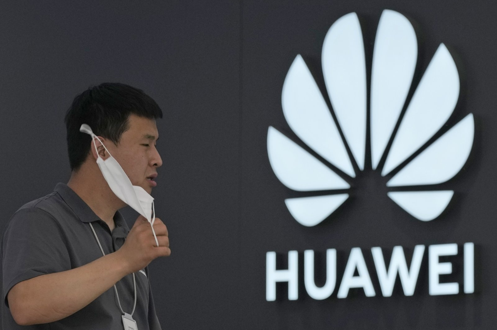 A worker waits for customers inside a Huawei store in Beijing, China, on June 2, 2021. (AP Photo)